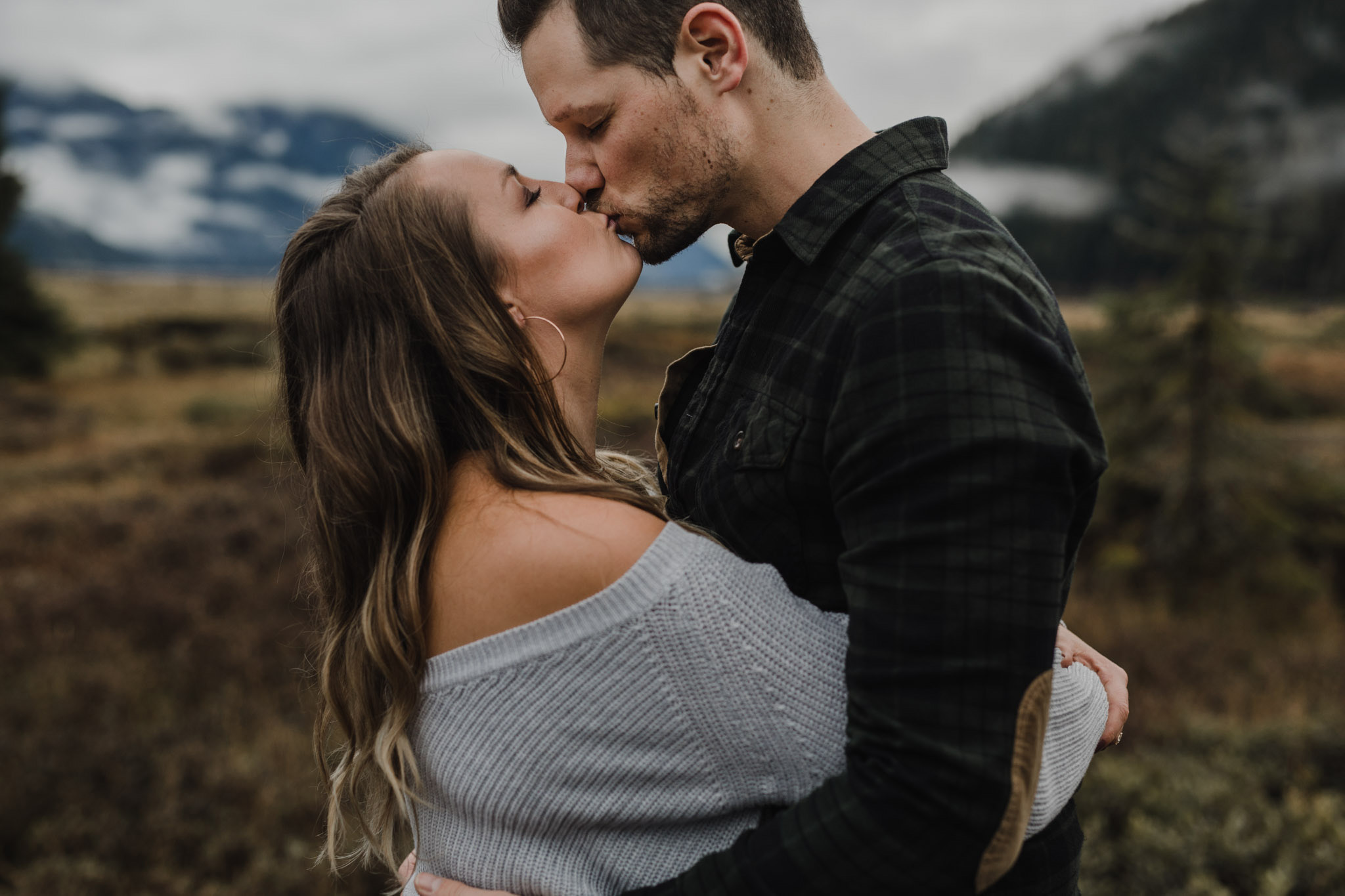 BC Mountain Top Engagement Photographer - smooching in the mountains