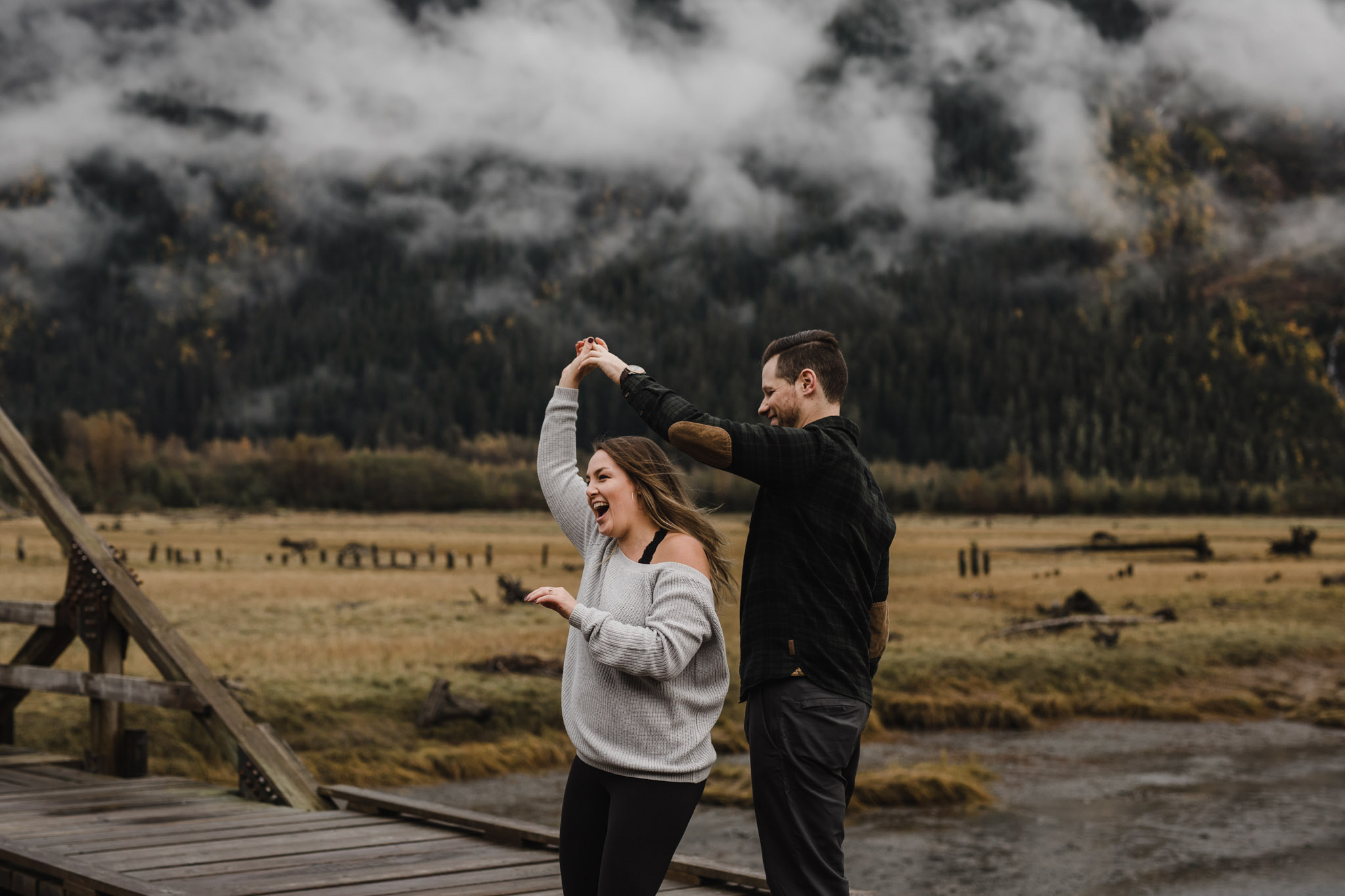 Engagement In the Mountains - dancing on a boardwalk