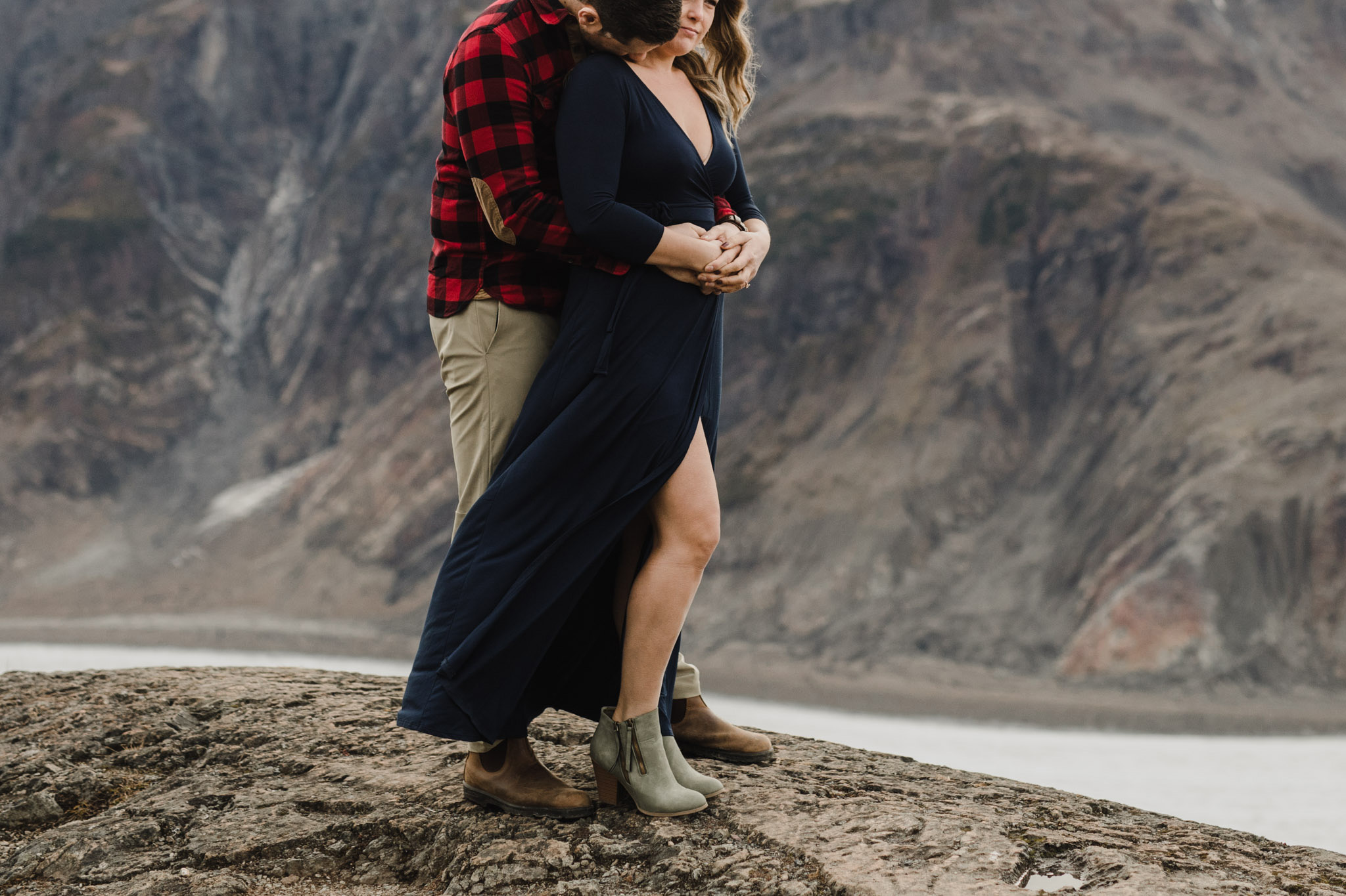 BC Mountain Top Engagement Photographer - kissing on the cliff