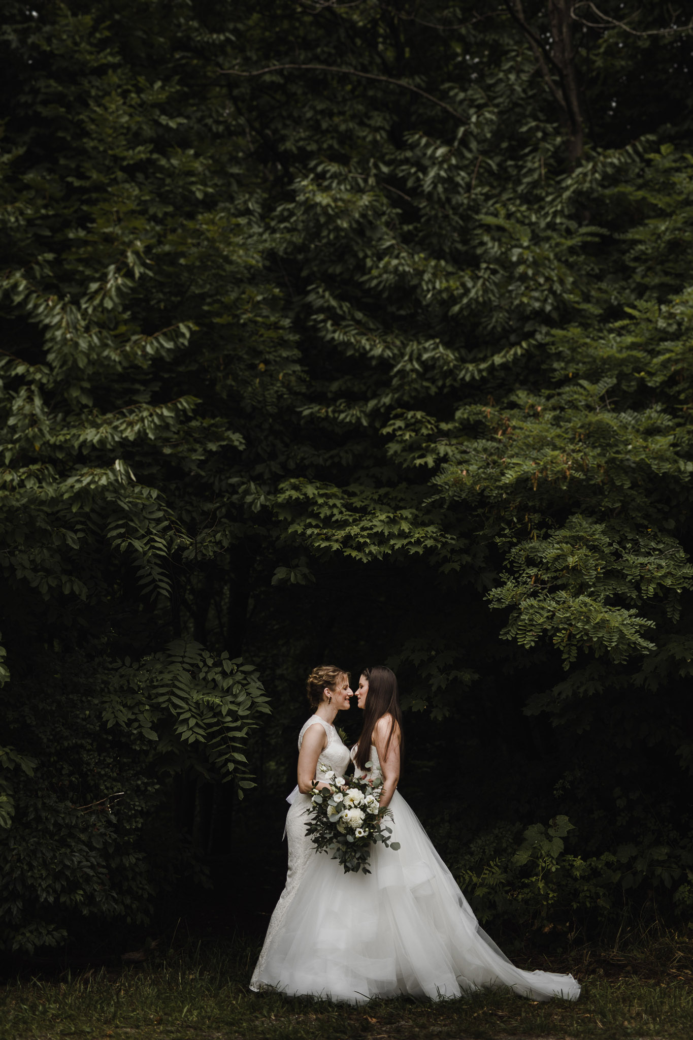 Balls Falls Conservation Area Wedding - kissing in the forest