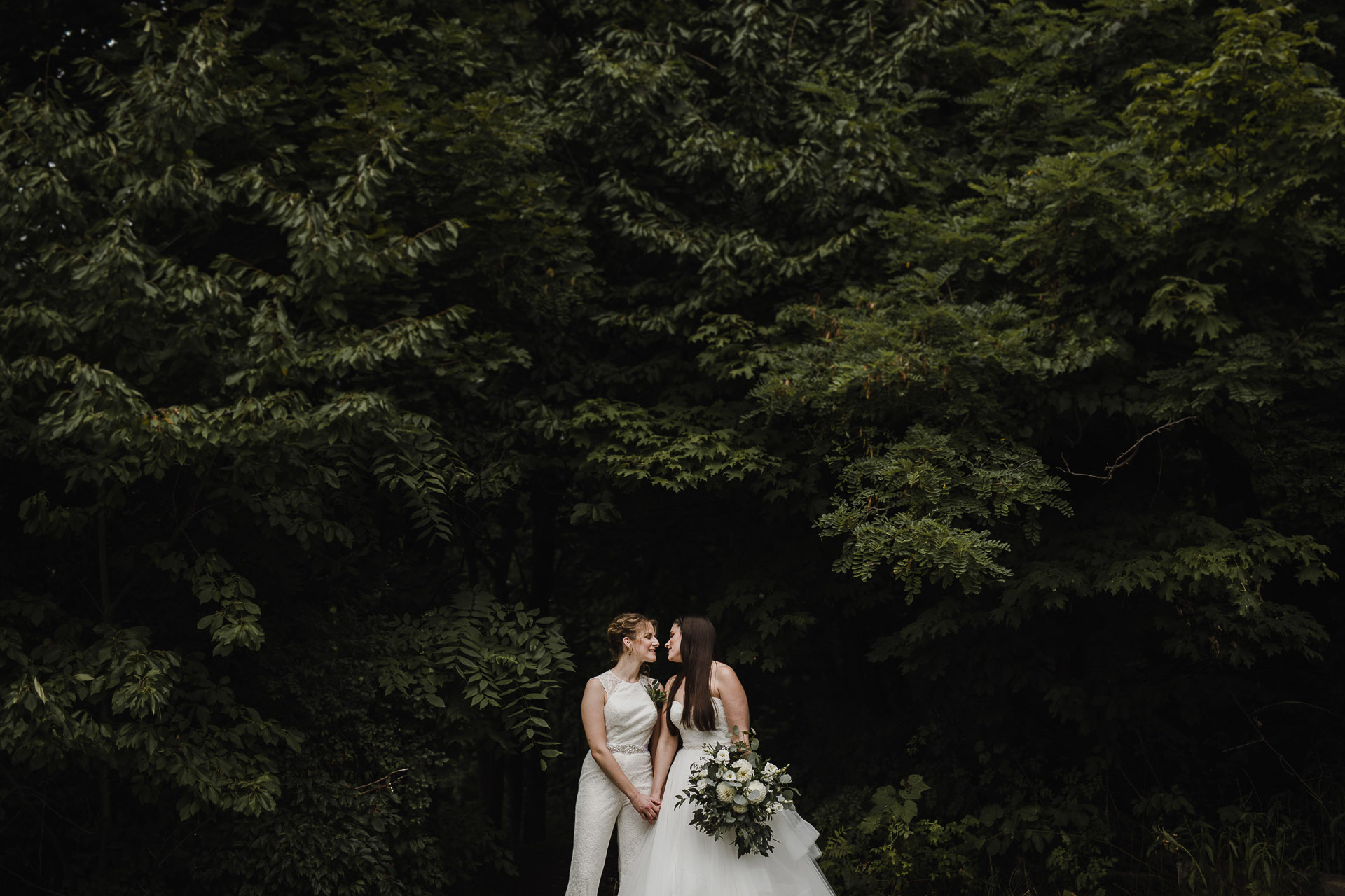 Balls Falls Conservation Area Wedding - brides kissing in the trees