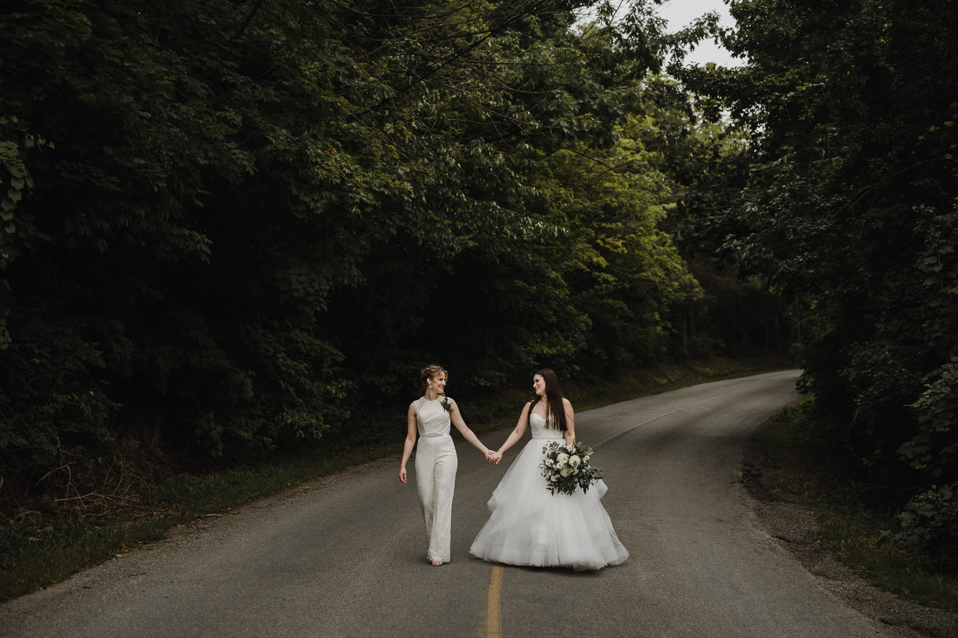 Balls Falls Conservation Area Wedding - holding hands in the road