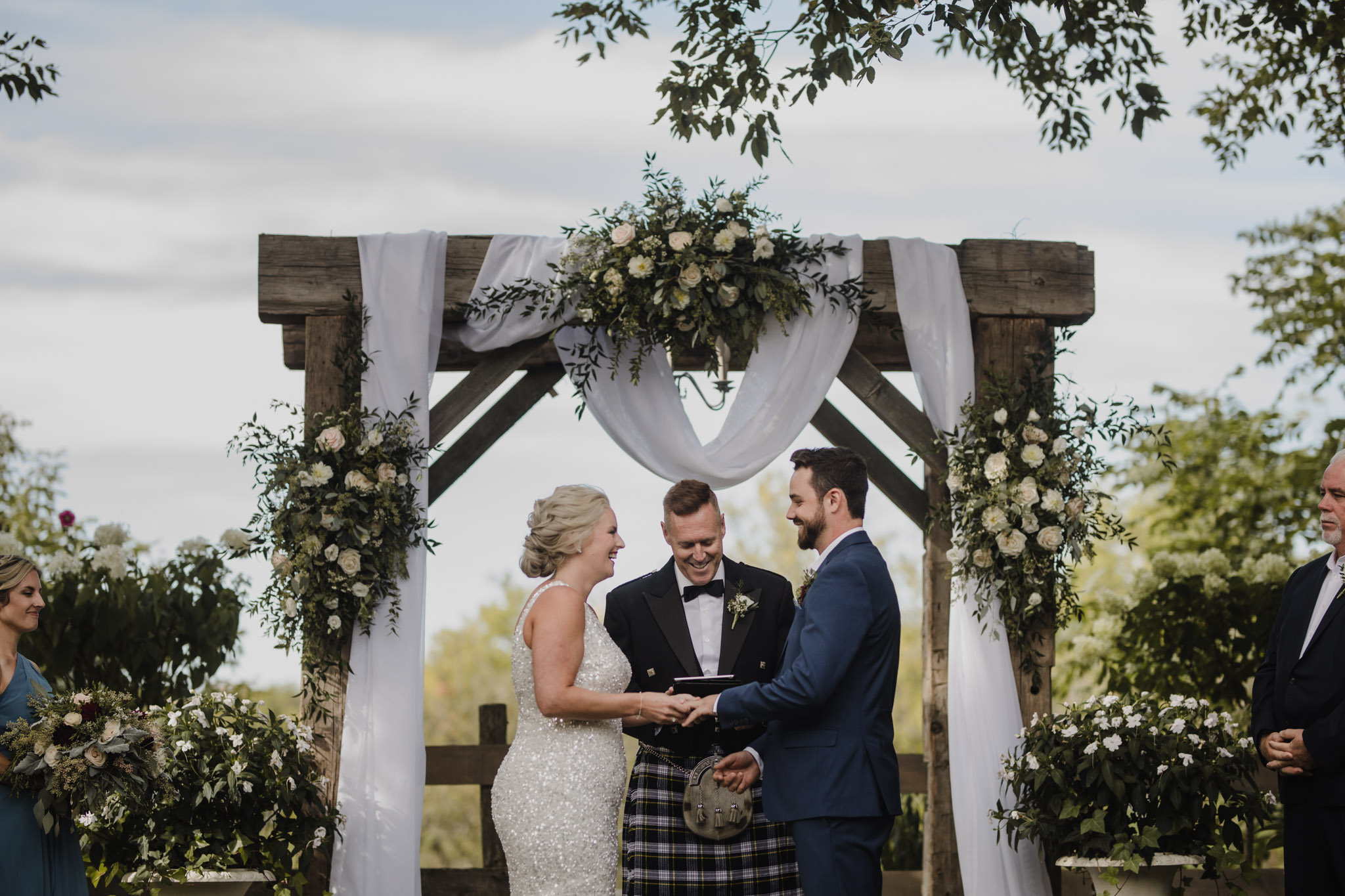 Century Barn Wedding Photographer - laughs at the alter