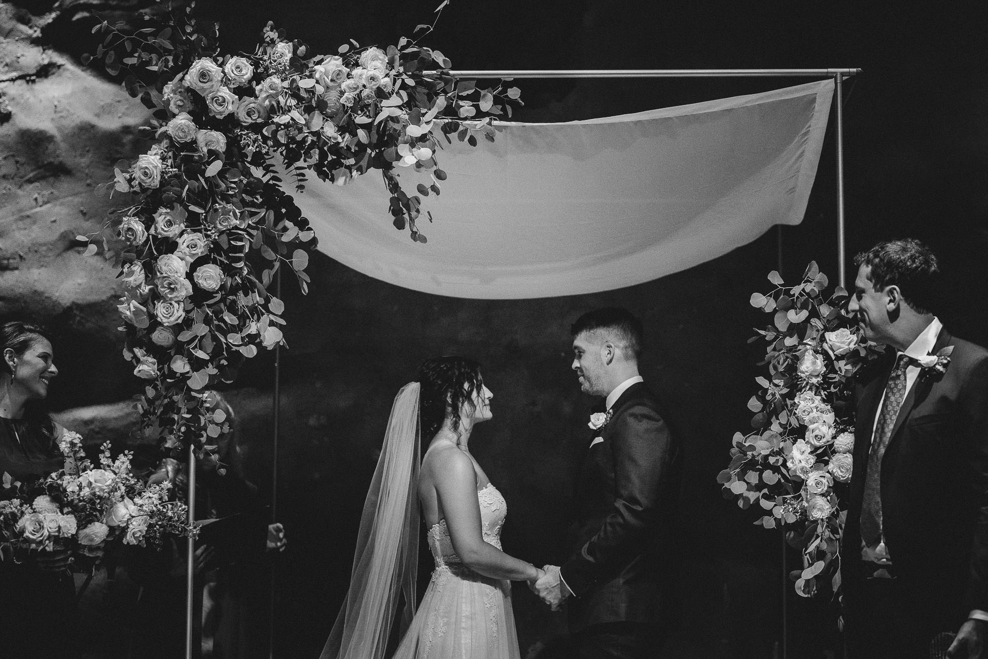 Distillery District Wedding - Bride and Groom at alter in Fermenting Cellar