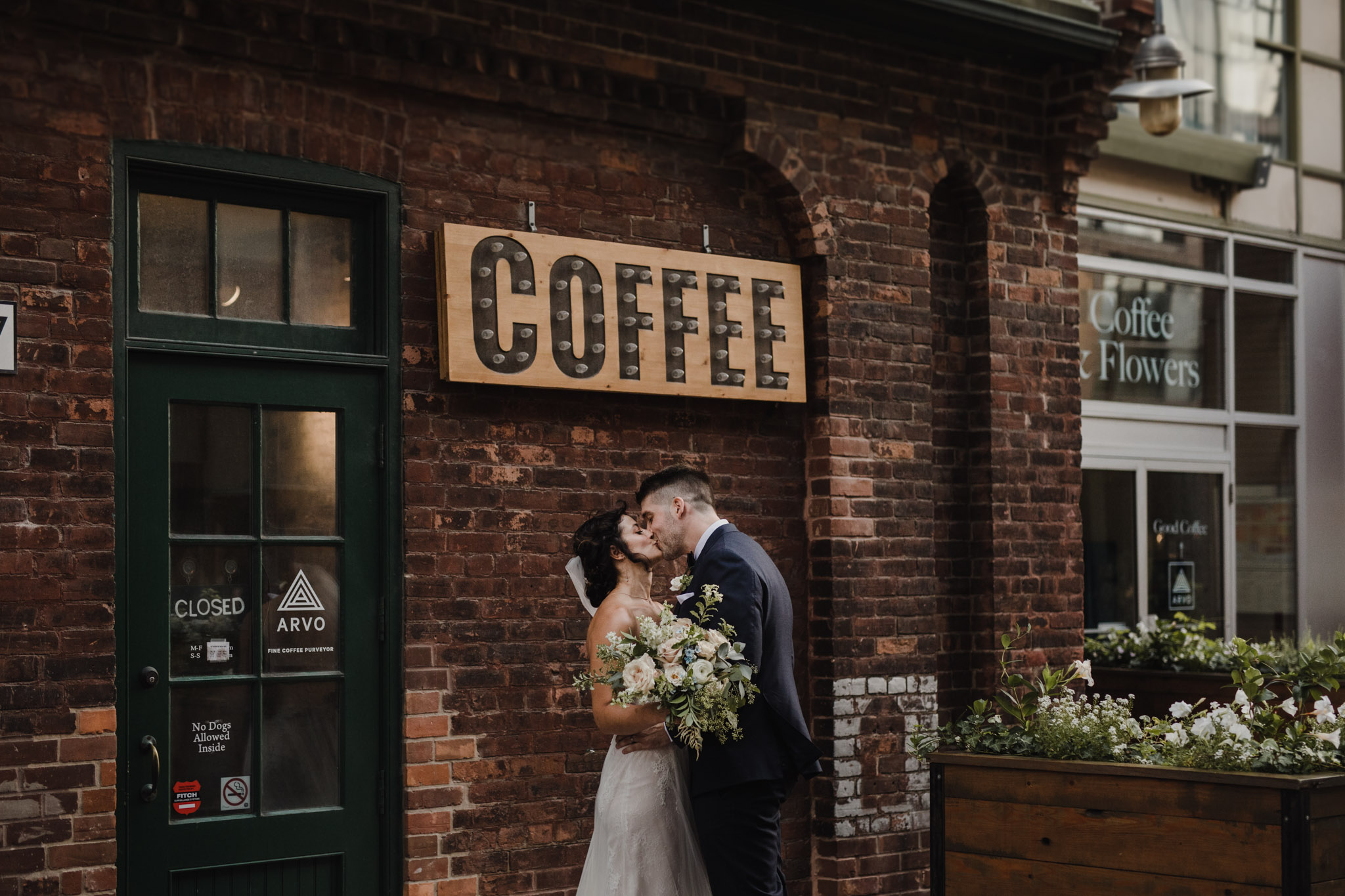 Distillery District Wedding - kissing and coffee shop