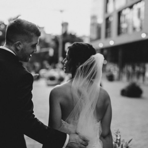 Bride and groom embrace in Toronto Distillery District wedding