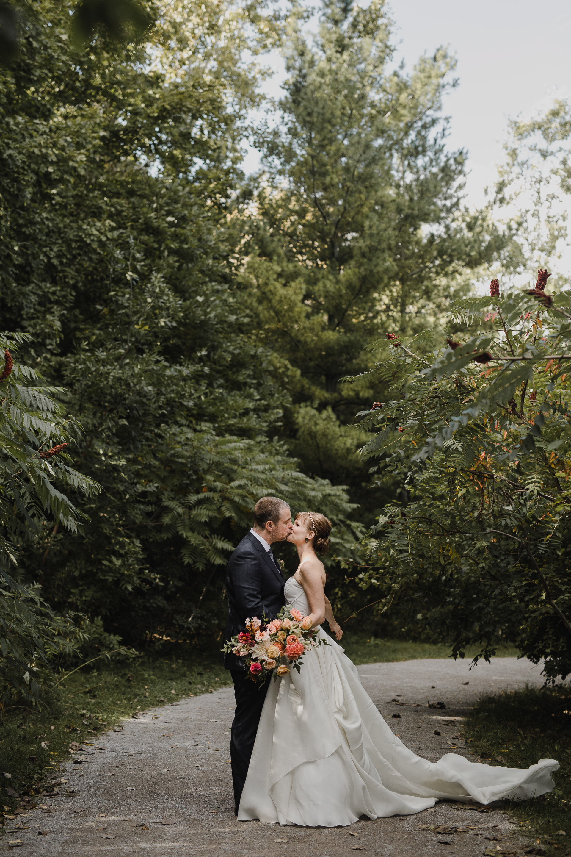 Evergreen Brickworks wedding photographer - kissing in the trees