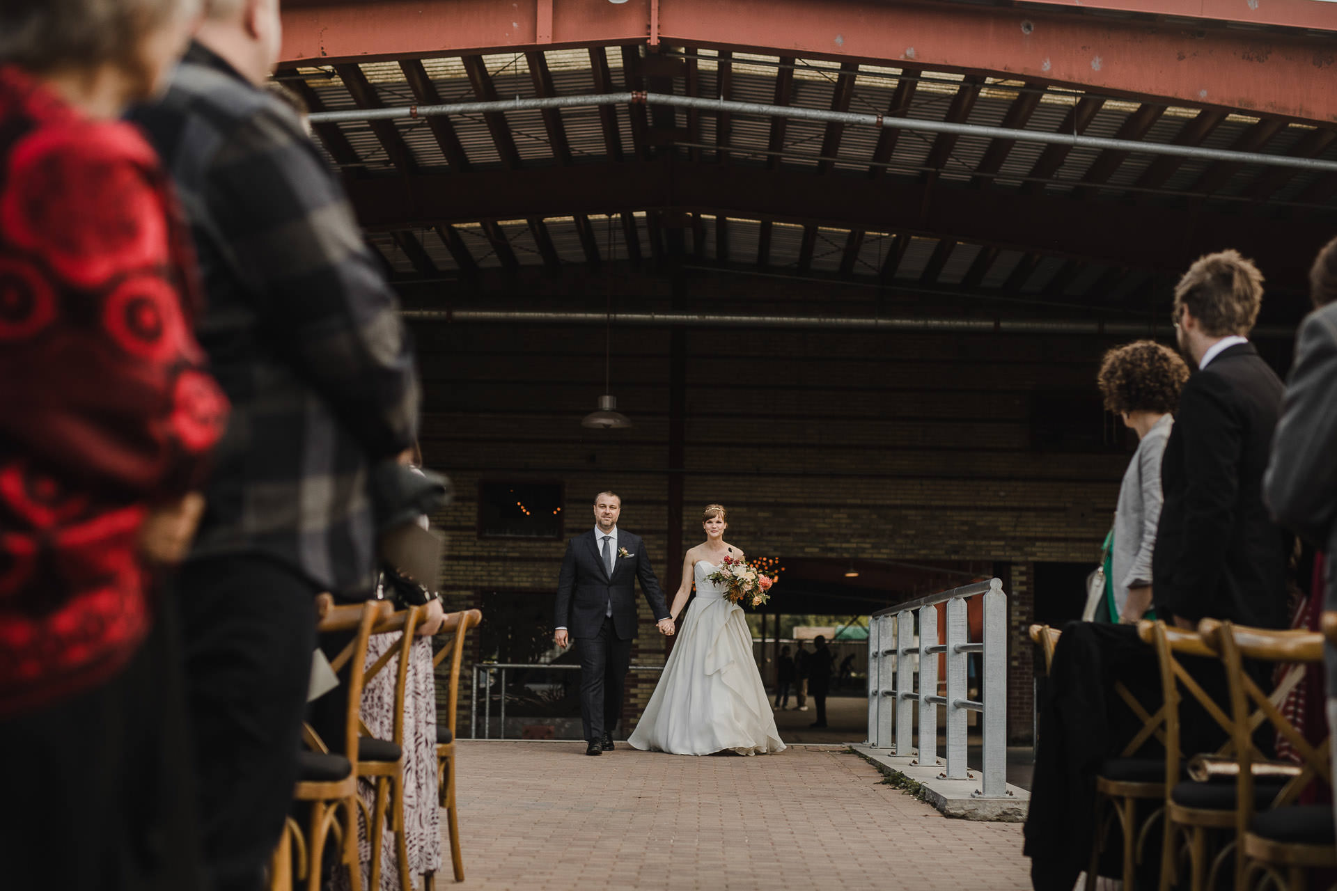 Evergreen Brickworks wedding photographer - bride walking down the aisle