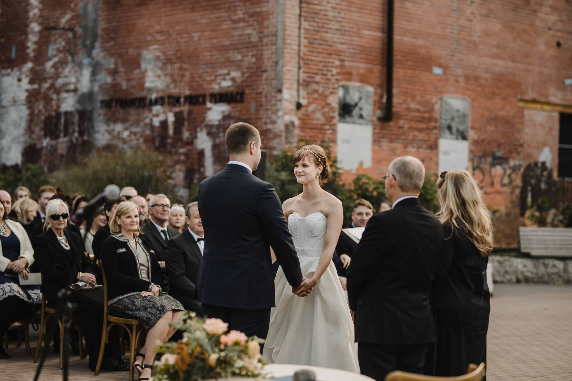 Evergreen Brickworks wedding photographer - bride and groom holding hands