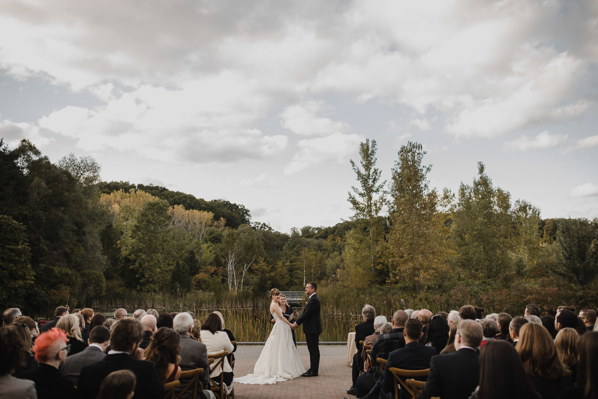 Evergreen Brickworks wedding photographer - bride and groom at the pond