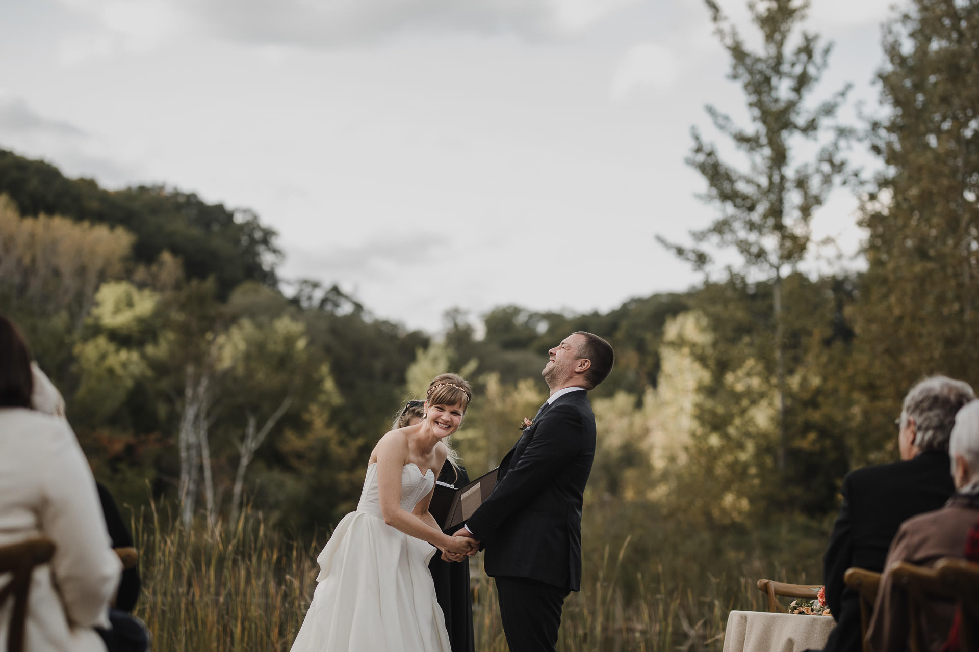 Evergreen Brickworks wedding photographer - bride and groom laughing