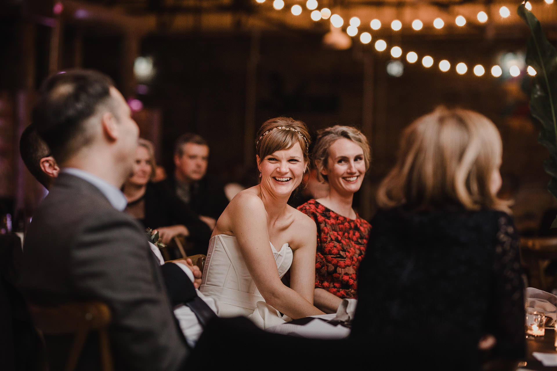 Evergreen Brickworks wedding photographer - bride laughing at speeches