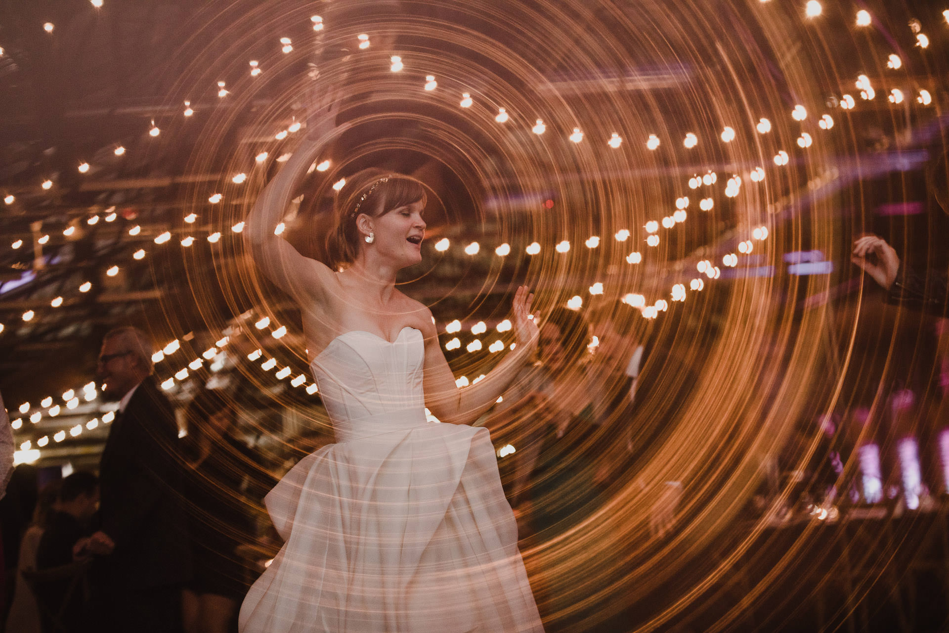Evergreen Brickworks wedding photographer - bride dancing