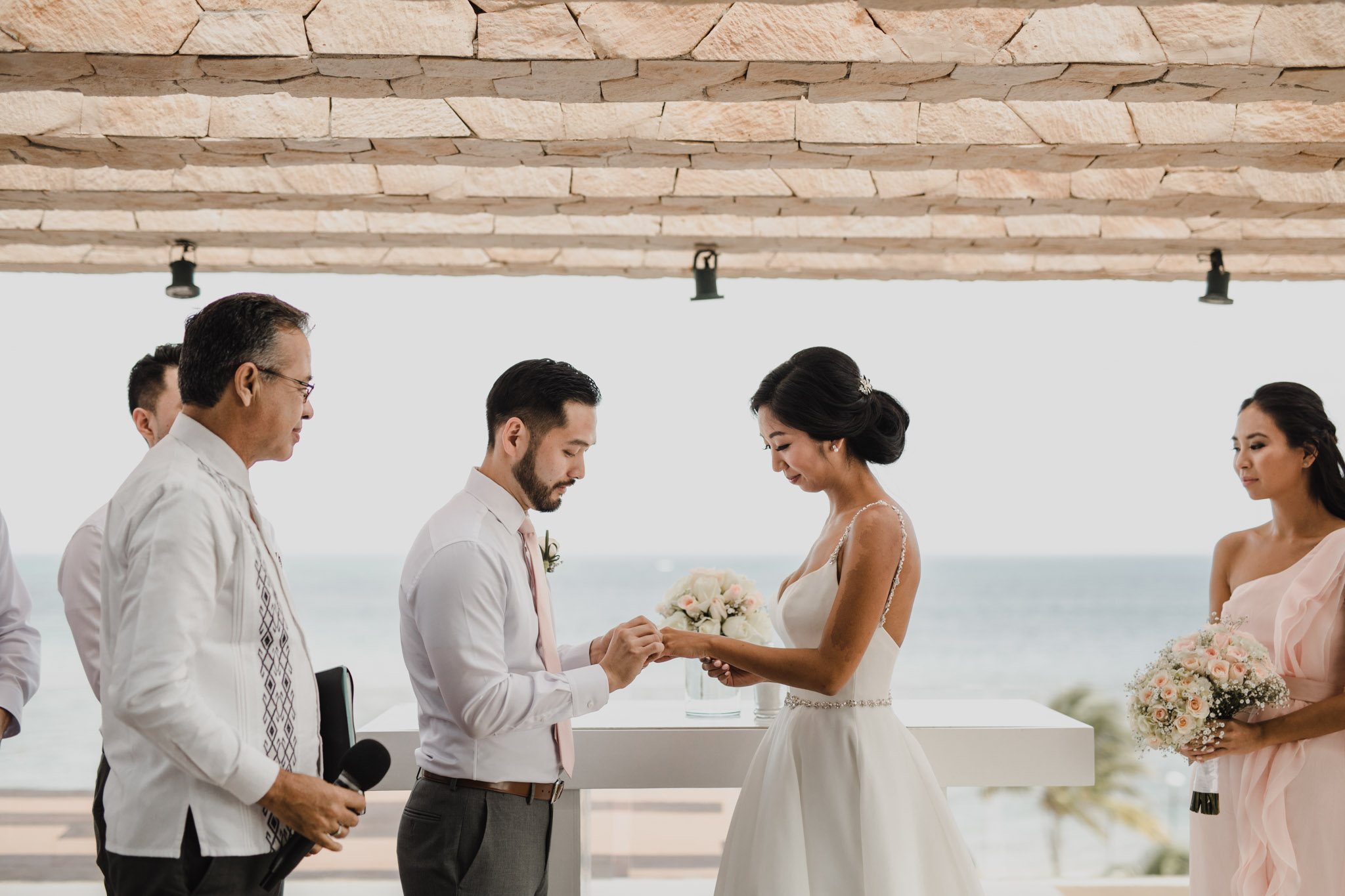 Cancun Mexico Wedding - exchanging rings
