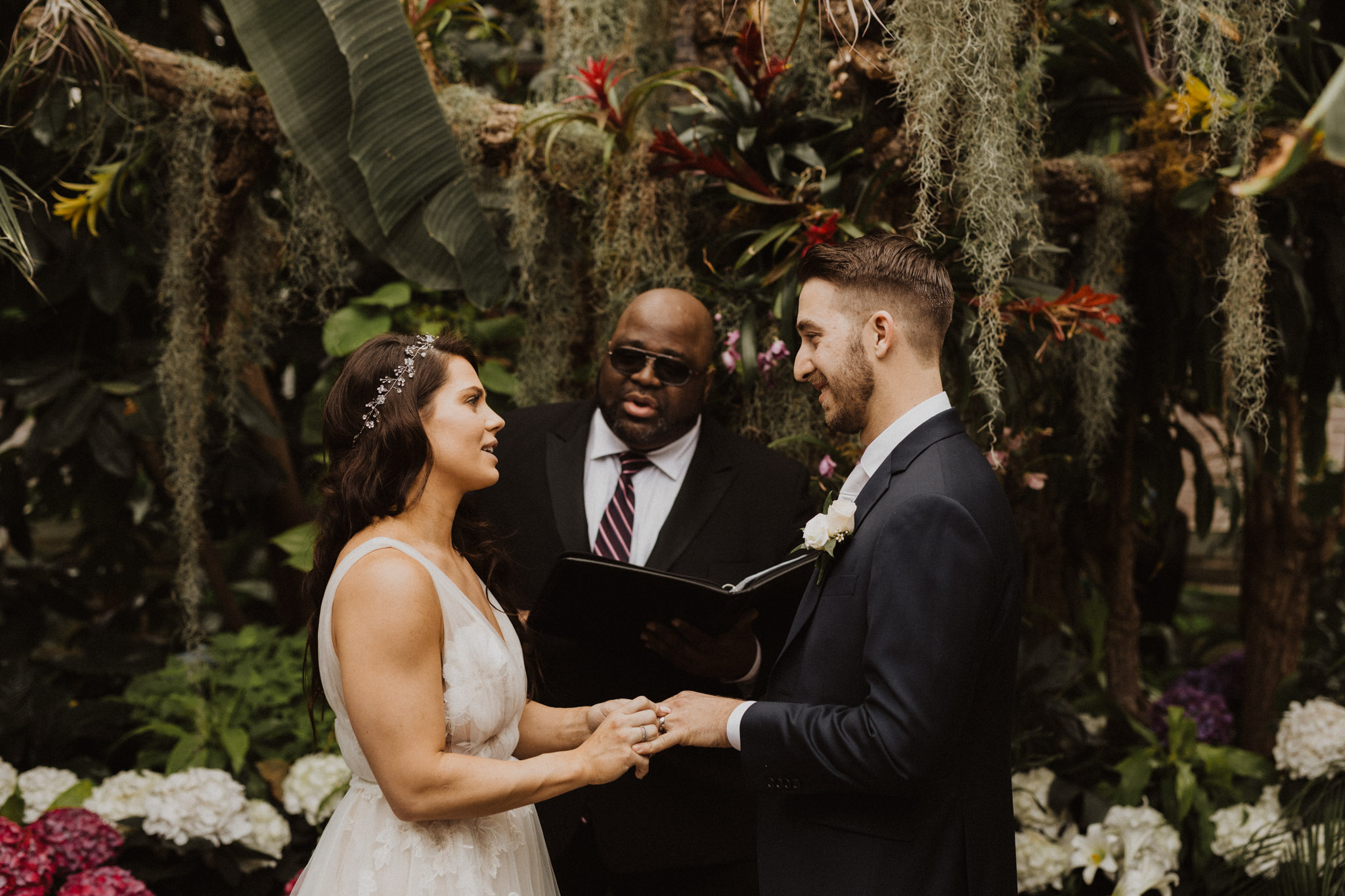 Greenhouse Elopement Allan Gardens Toronto - exchanging rings