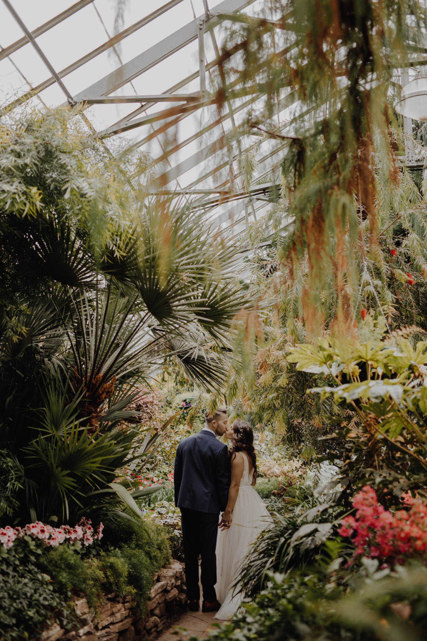 Greenhouse Elopement Allan Gardens Toronto - bride and groom in lush garden
