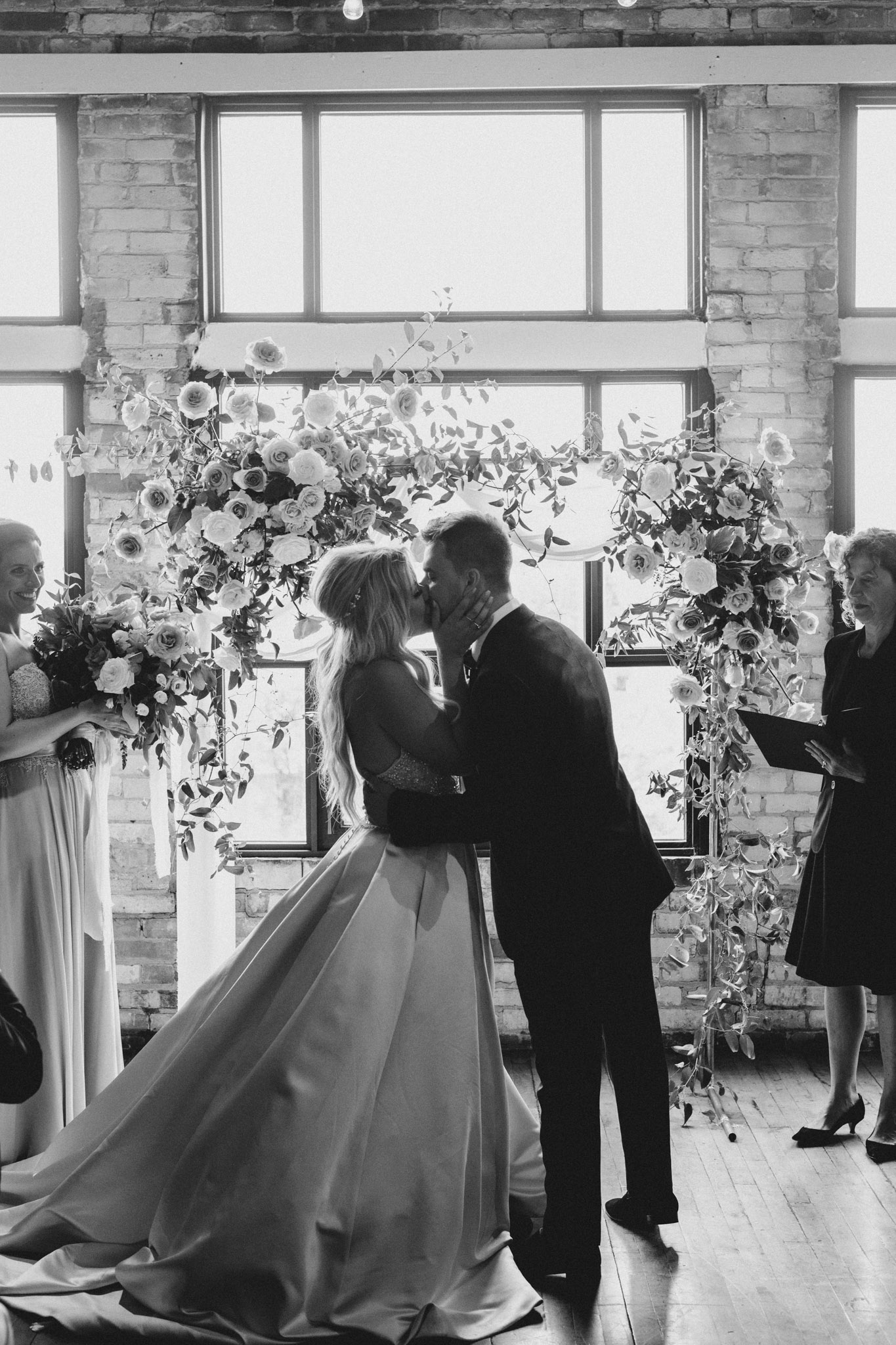 Epic kiss at the alter at The Burroughes Wedding. Love By Lynzie. Wedding Photographer Jennifer See Studios.