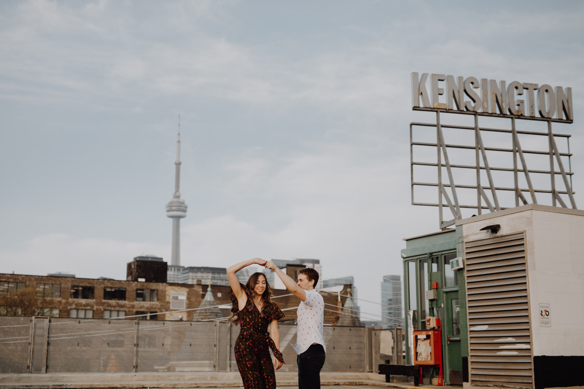 Dancing on the rooftop. Kensington Engagement. Jennifer See Studios.