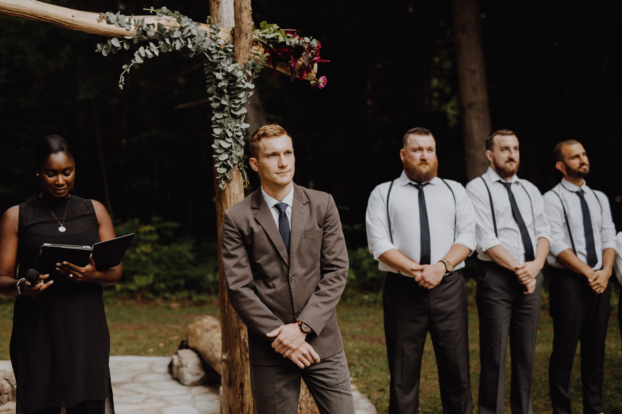 Outdoor Camp Wedding - groom at the alter