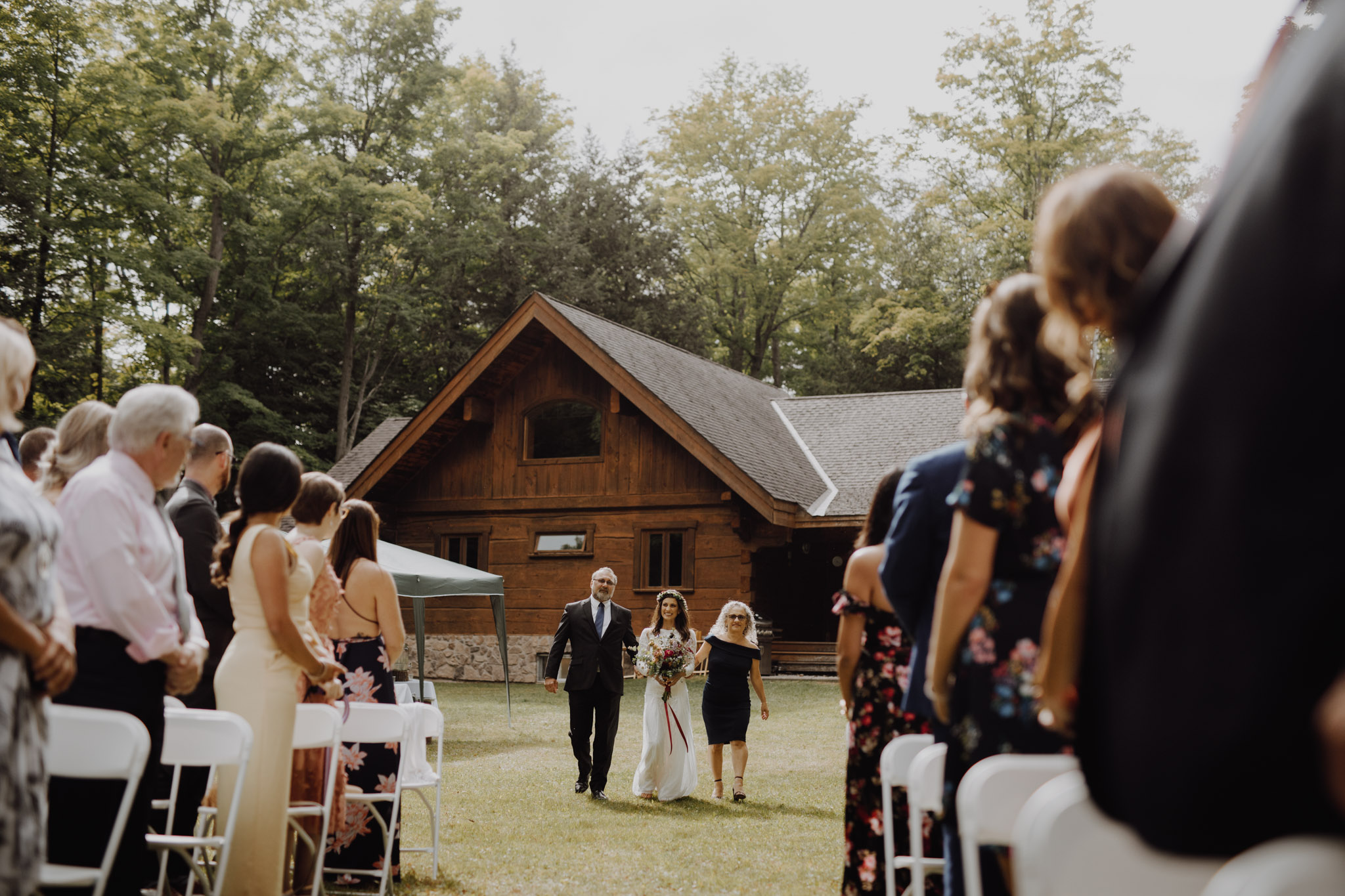 Outdoor Camp Wedding - bride walking down the aisle