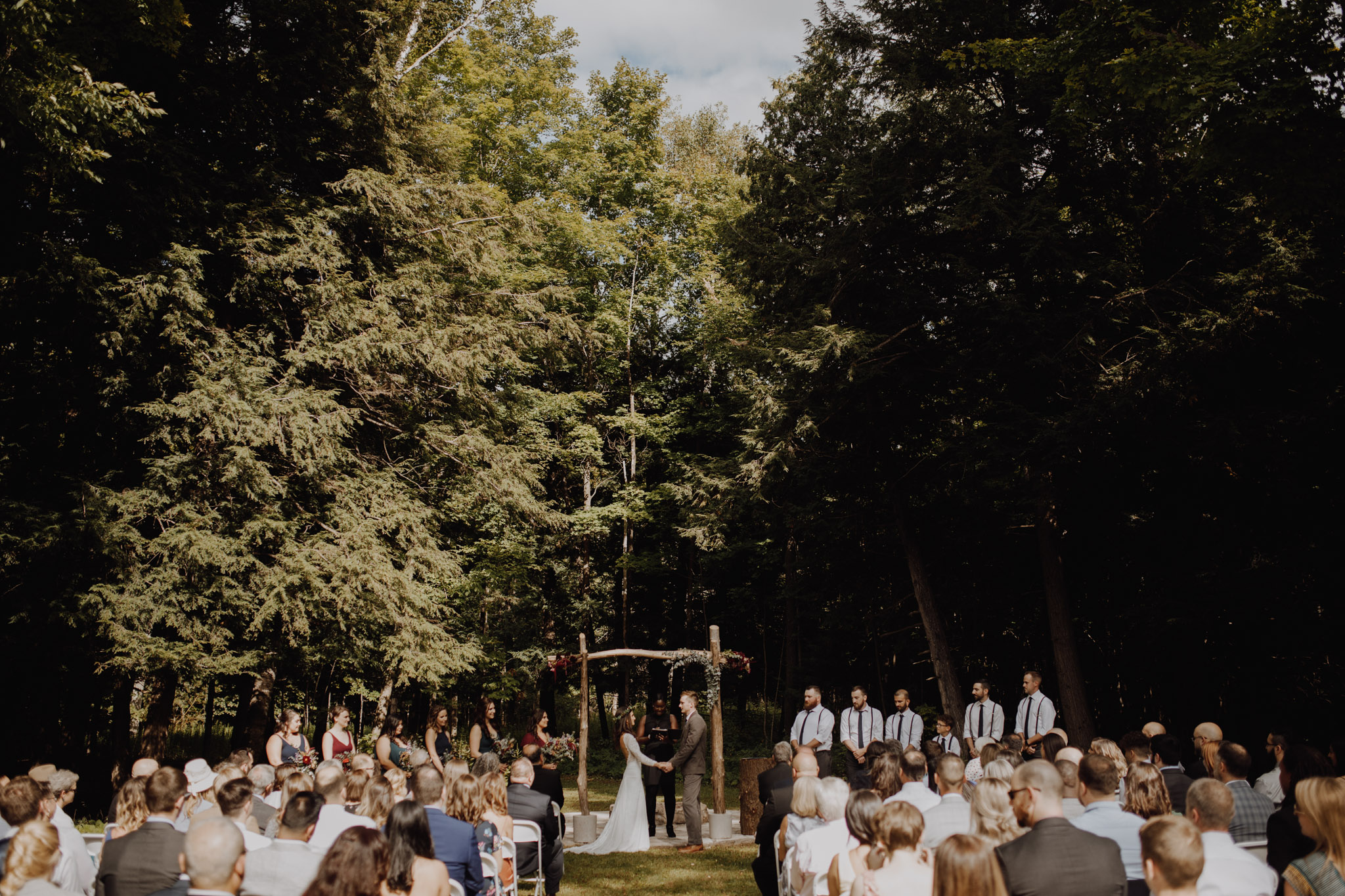 Outdoor Camp Wedding - bride and groom at the alter