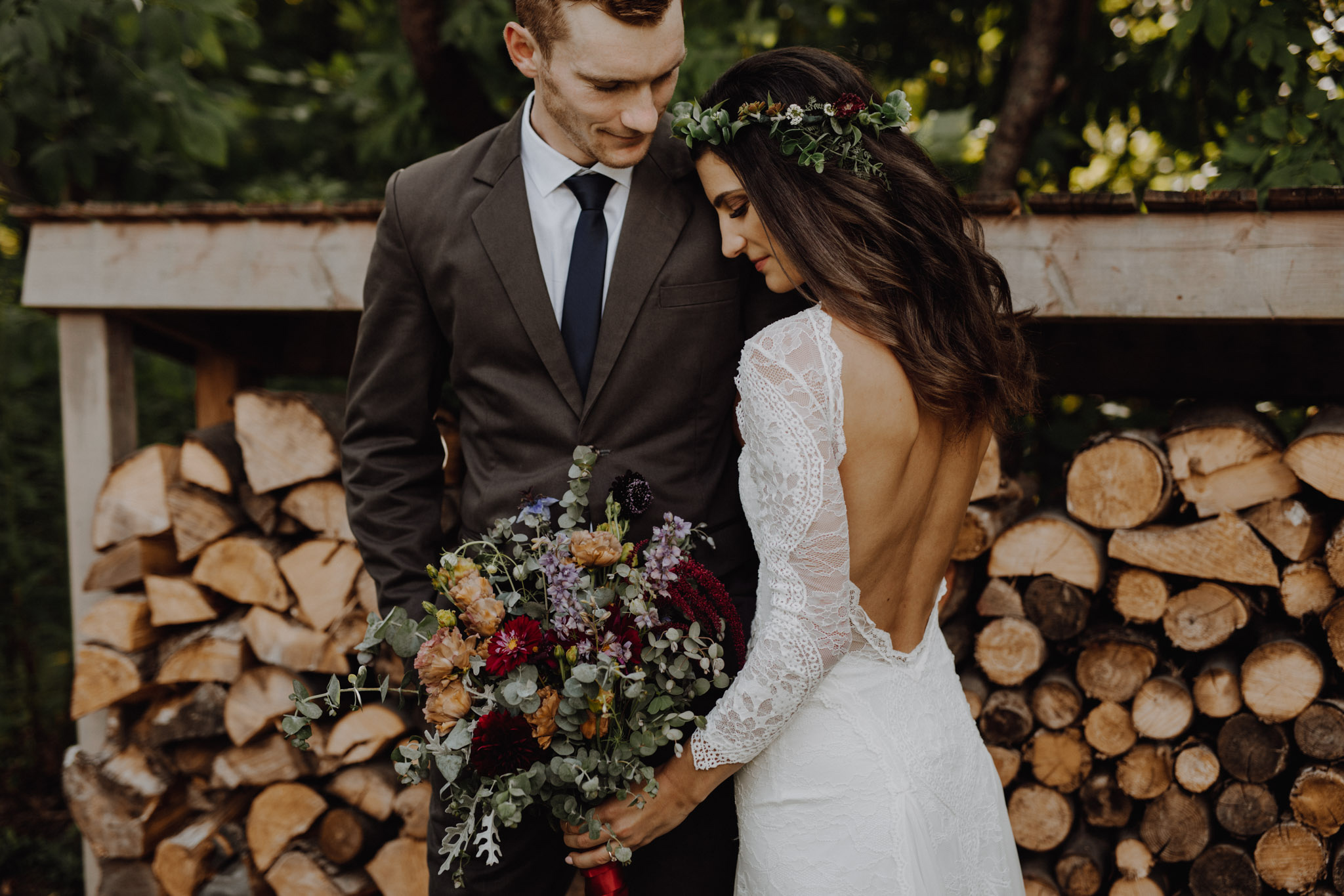 Outdoor Camp Wedding - portraits by the woodpile