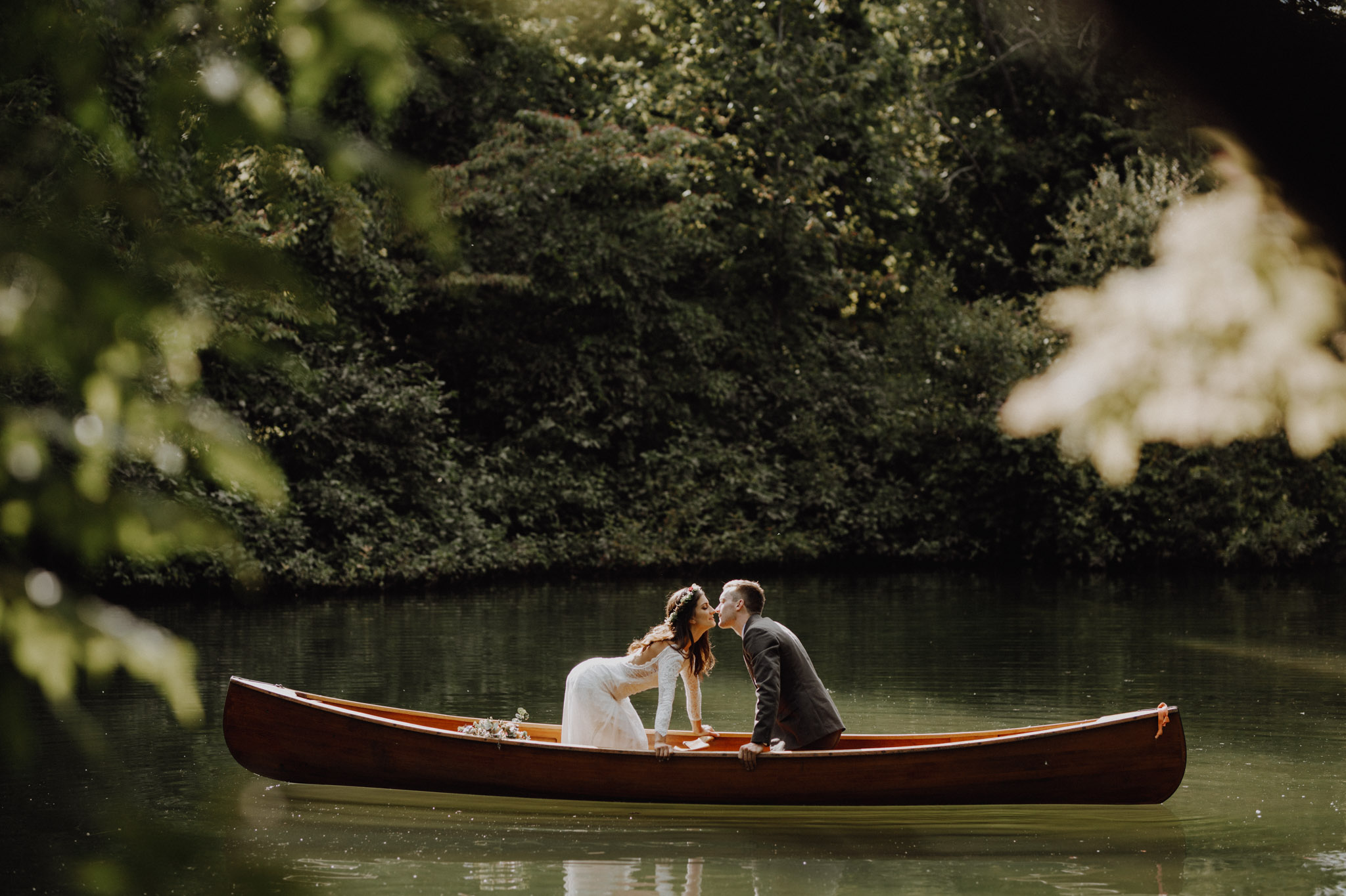 Outdoor Camp Wedding - kissing in the canoe