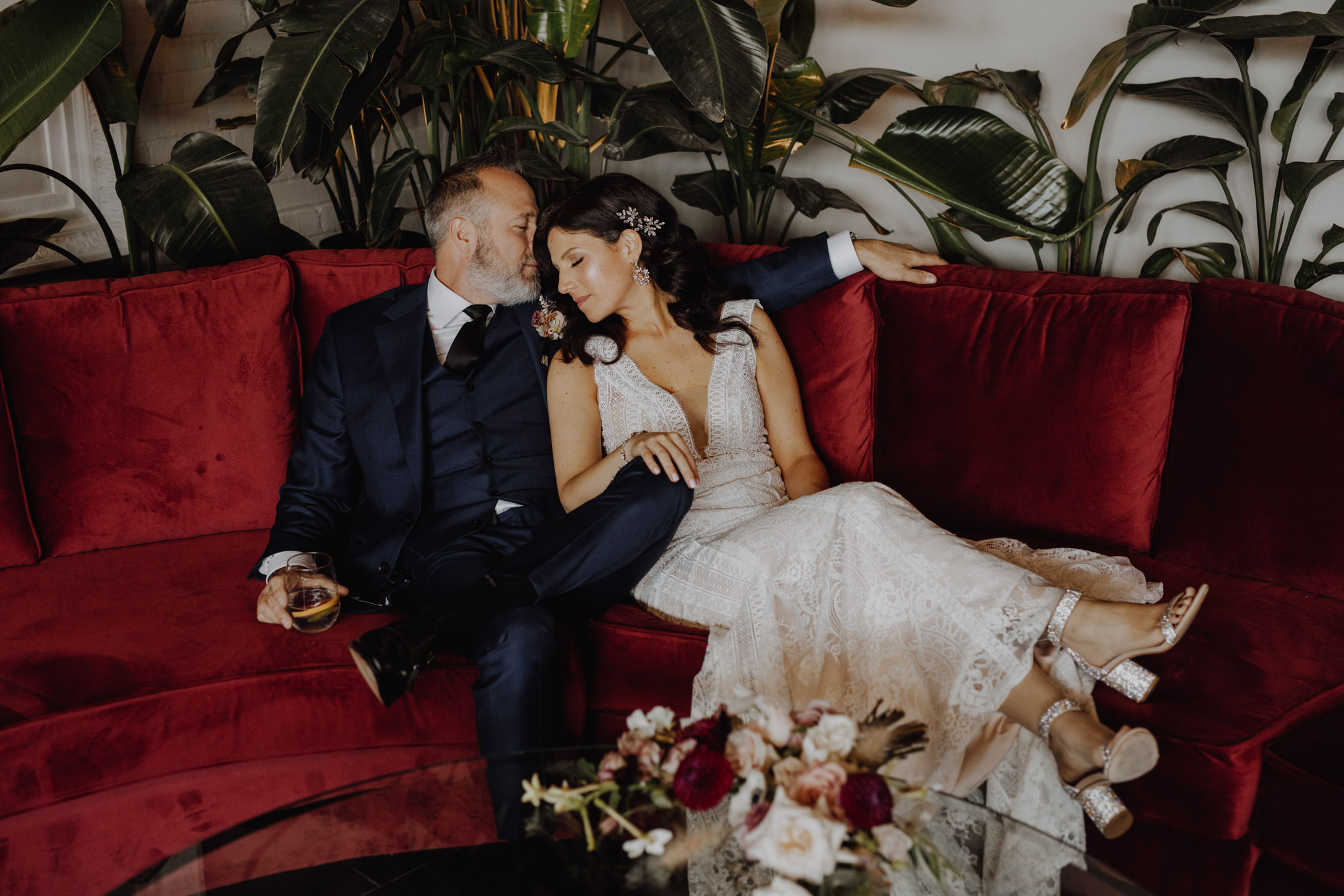 District 28 Wedding Toronto - Bride Groom Red Couch