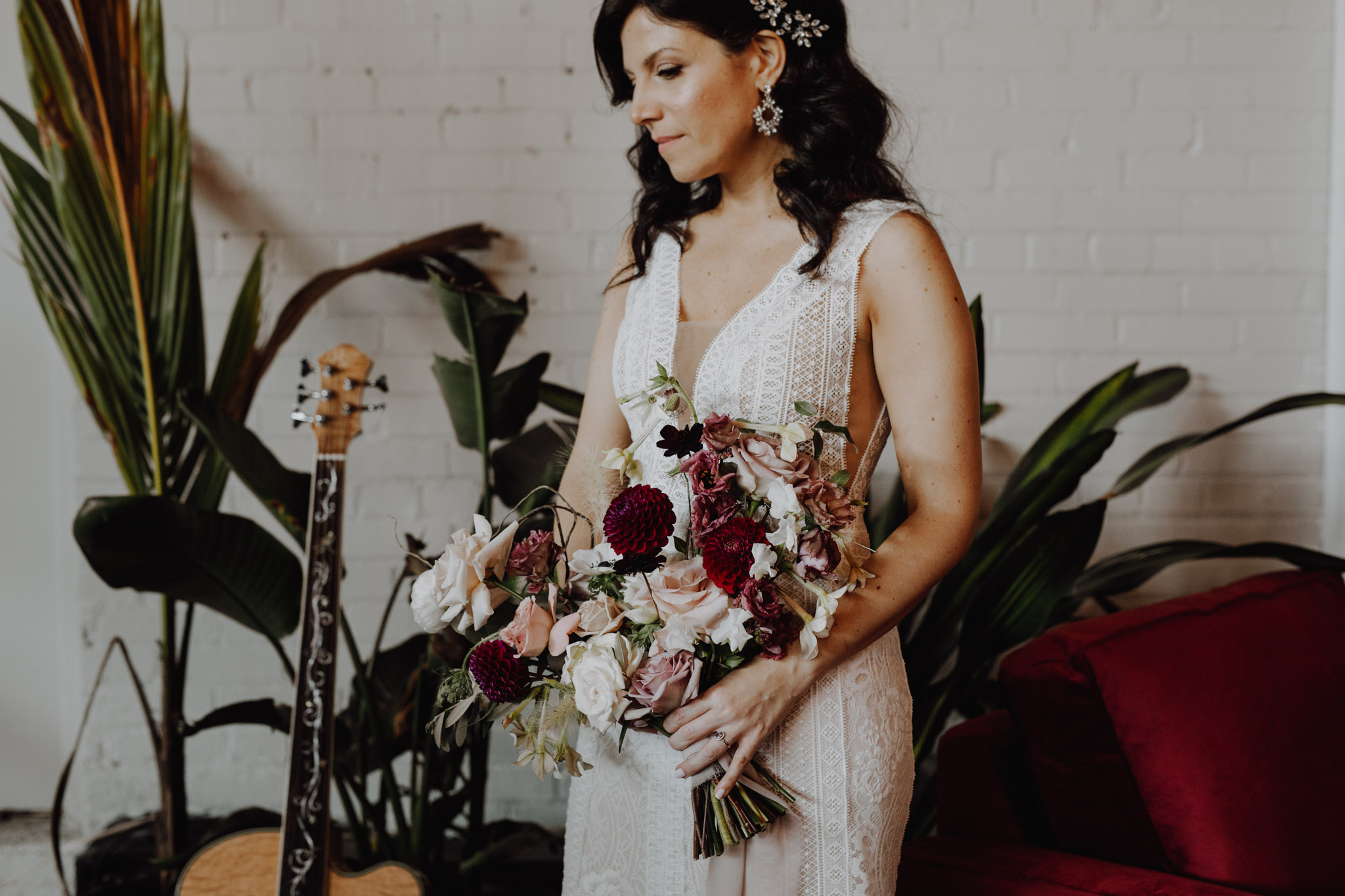 District 28 Wedding Toronto - Bride with florals and guitar
