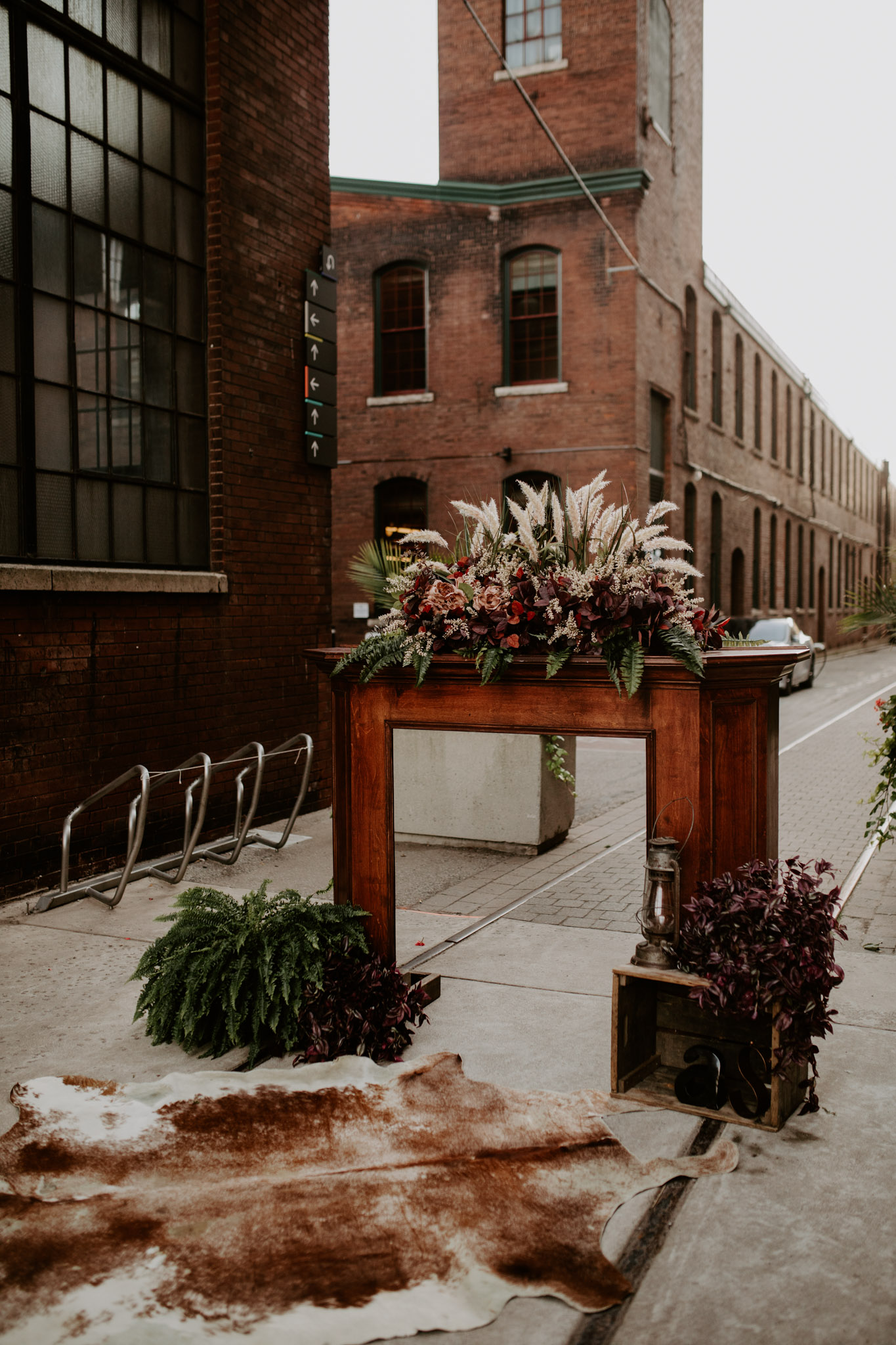 Caffino Wedding - outdoor alter fireplace with fall florals