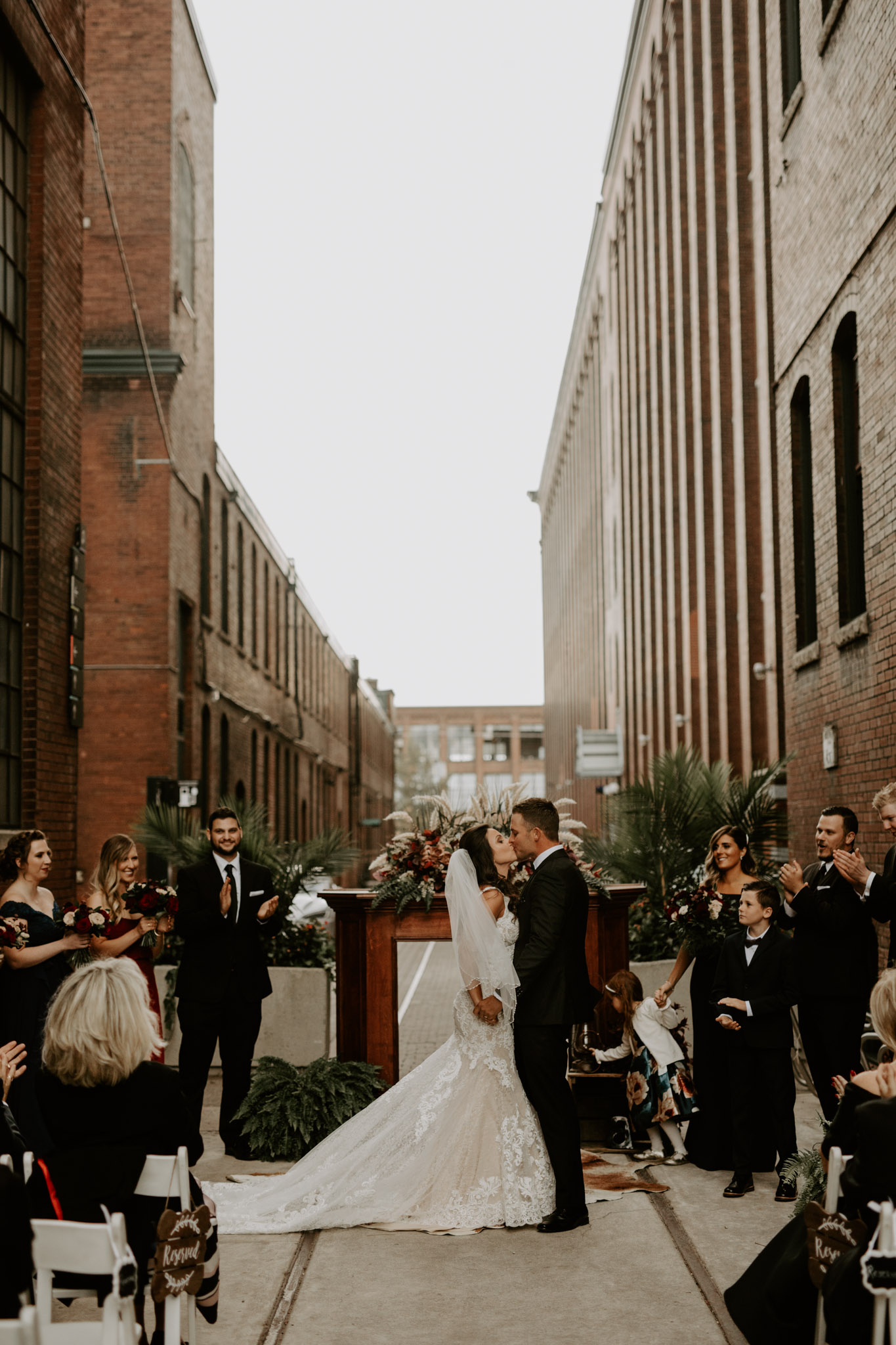 Liberty Village Wedding Caffino - Newlyweds kiss at the alter outside