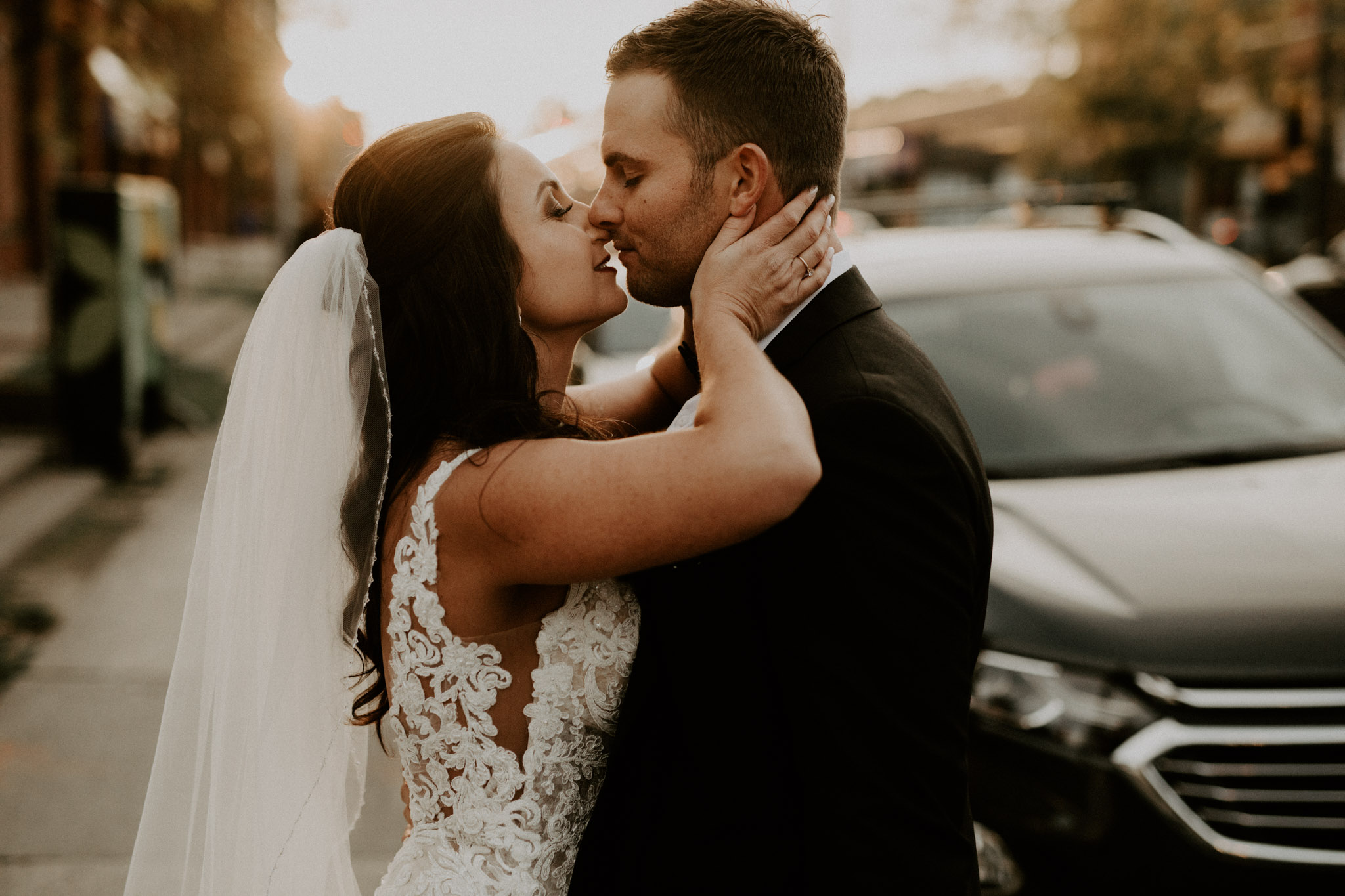 Caffino Wedding - bride and groom kiss at sunset