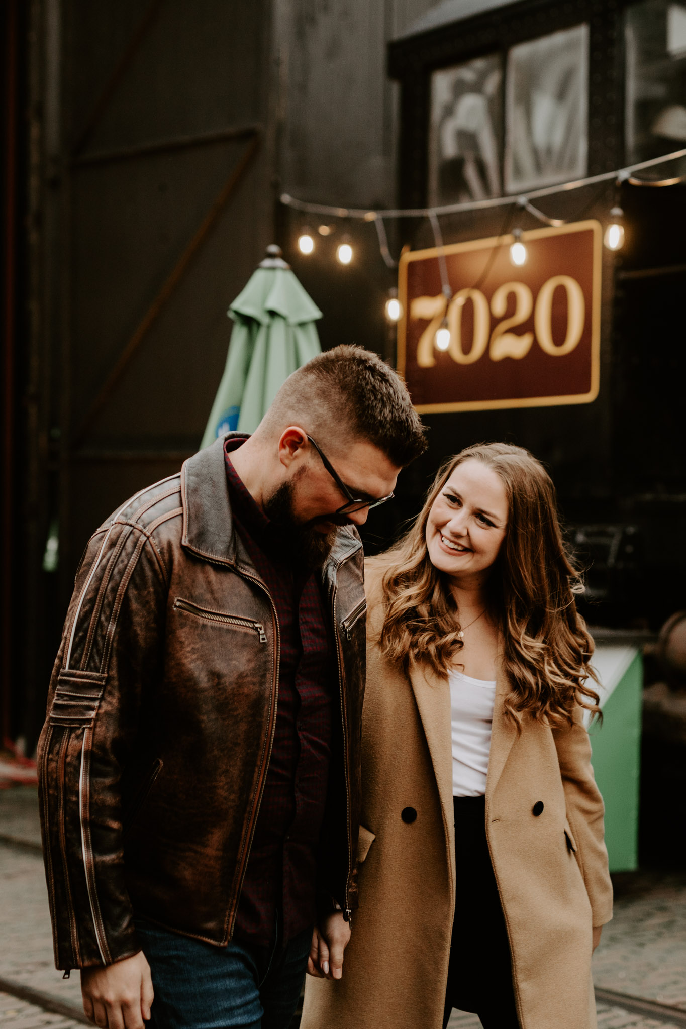SteamWhistle Brewery Engagement - couple walking and smiling