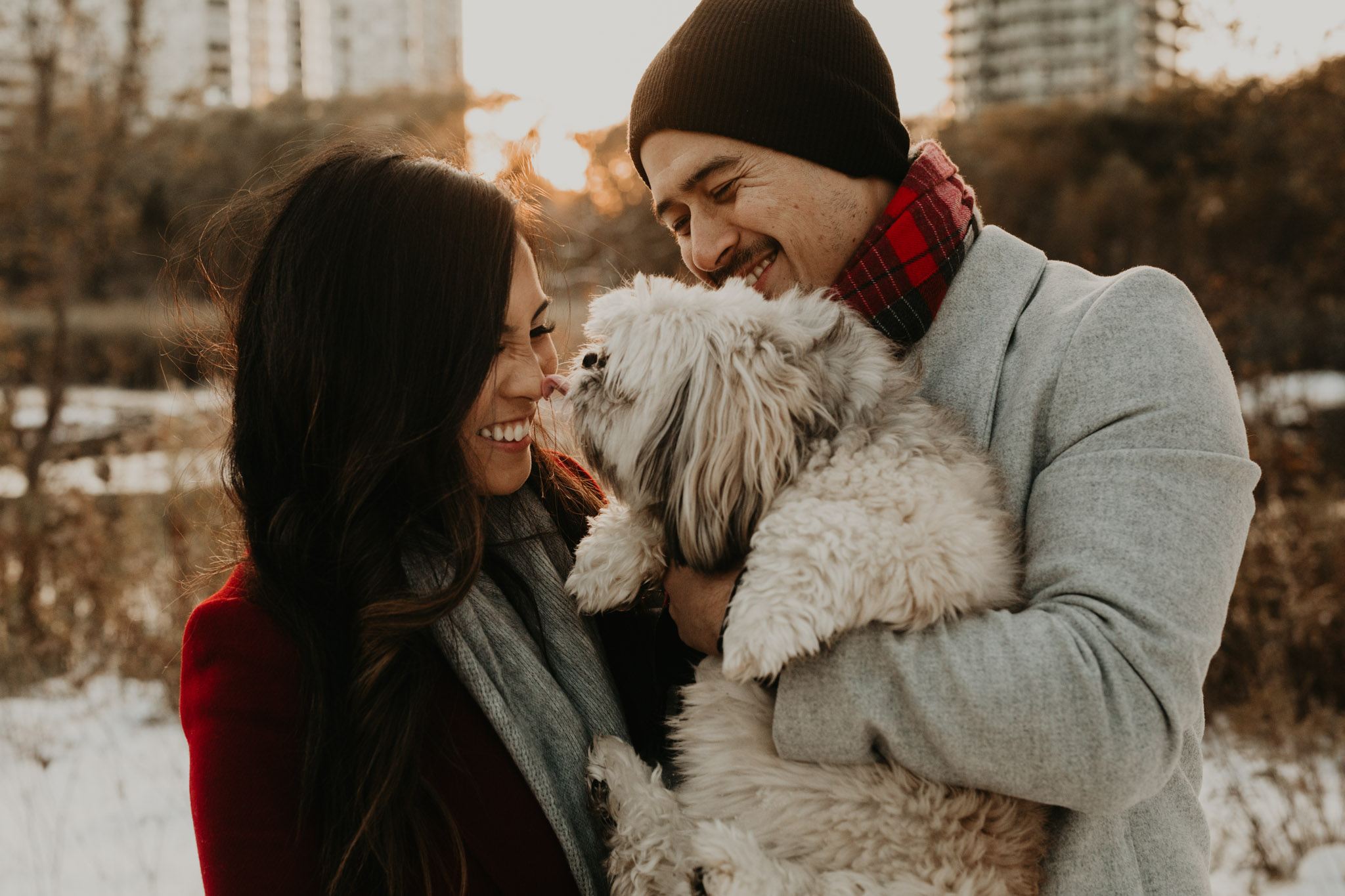 Winter Engagement in Toronto - dog kisses with couple