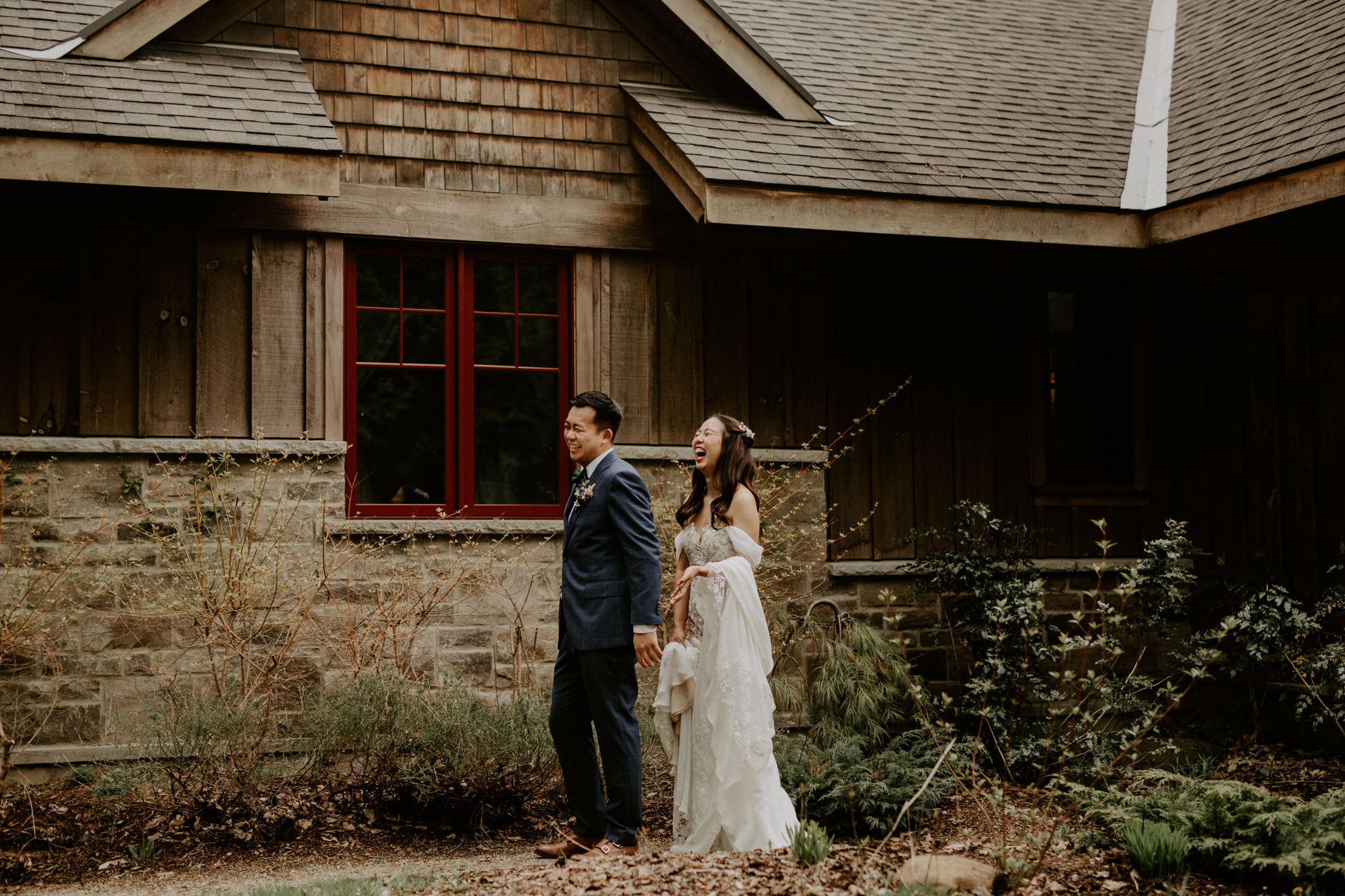Serenity Cottage Wedding - bride and groom in front of stone cottage