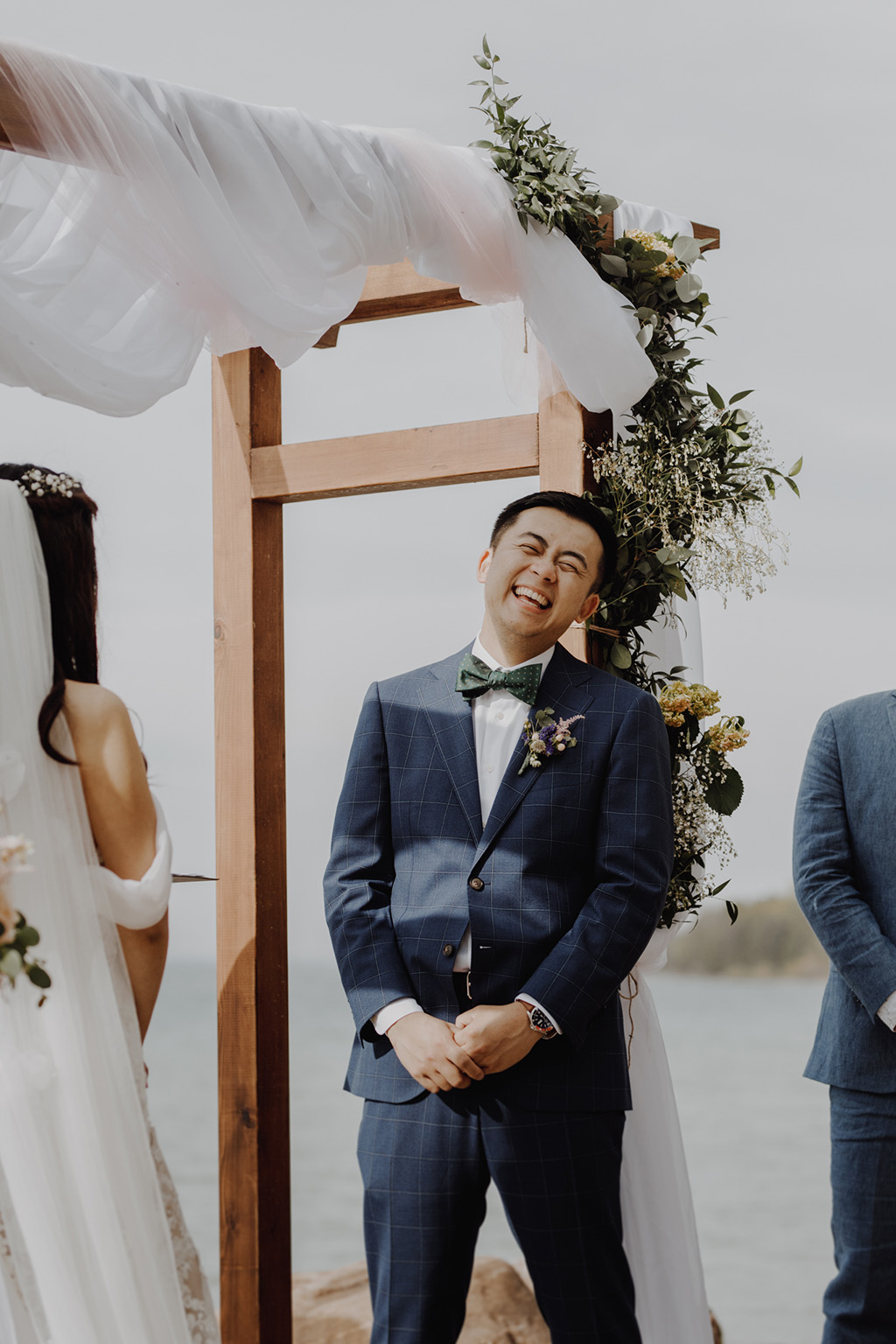 Serenity Cottage Wedding - groom laughing at lakeside alter