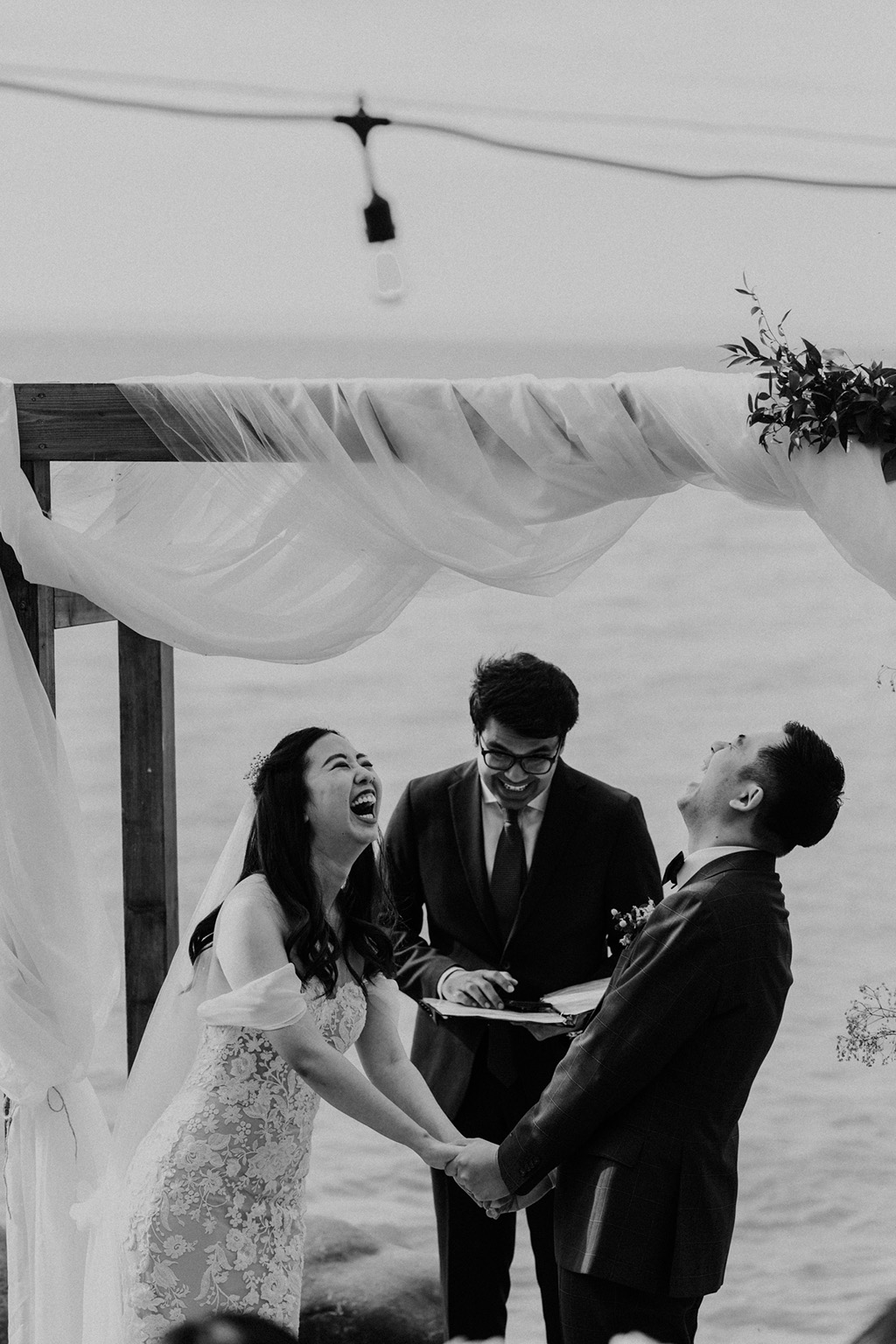 Serenity Cottage Wedding - bride and groom laughing at lakeside alter