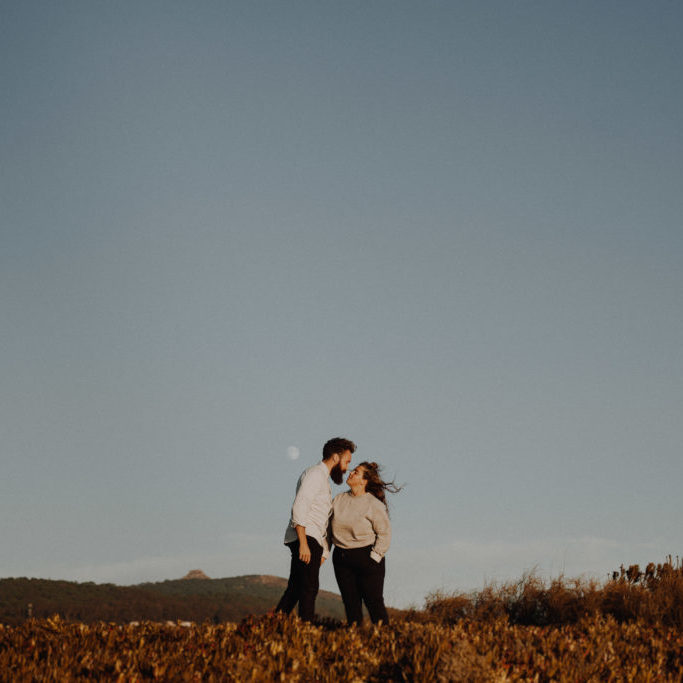 Destination Elopement Photographer - Connection Session in Portugal - cliff top with the moon