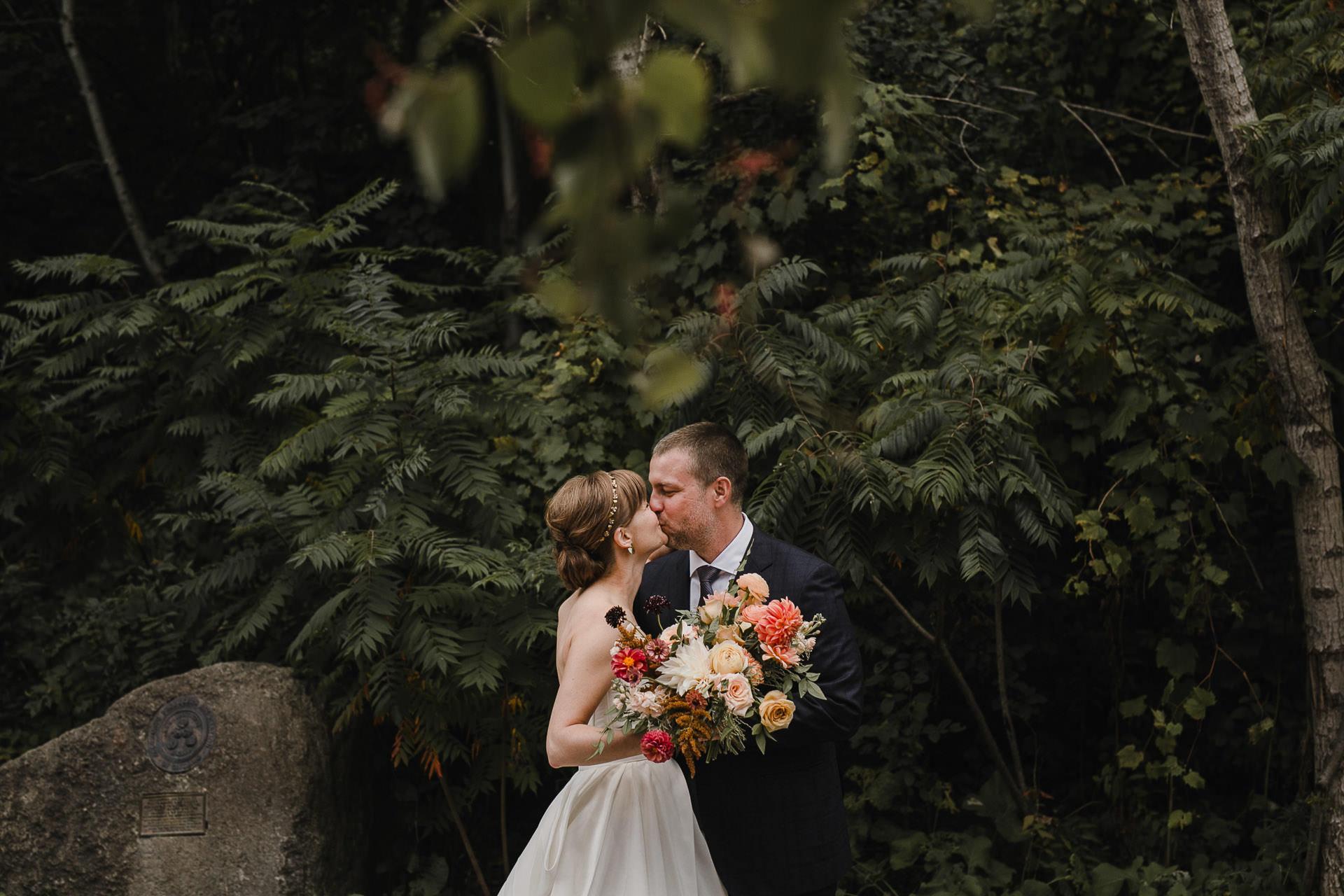 Evergreen Brickworks wedding photographer - first look kiss
