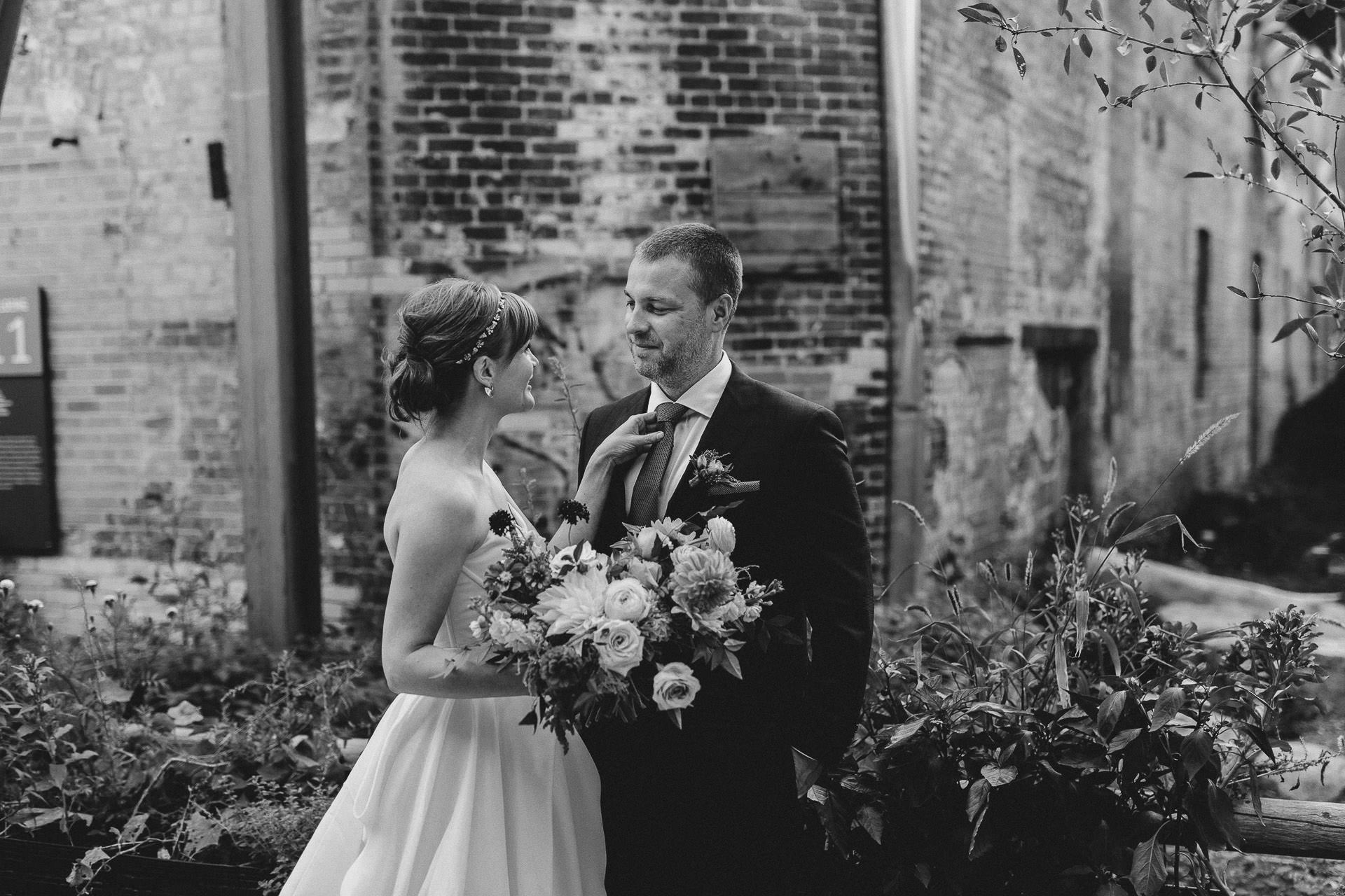 Evergreen Brickworks wedding photographer - bride fixing the grooms tie