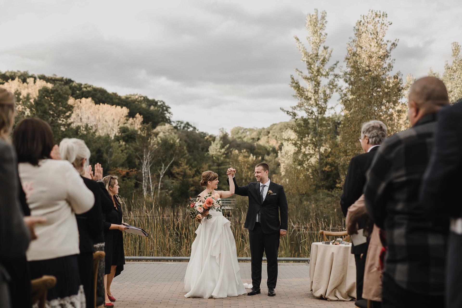 Evergreen Brickworks wedding photographer - bride and groom celebrate