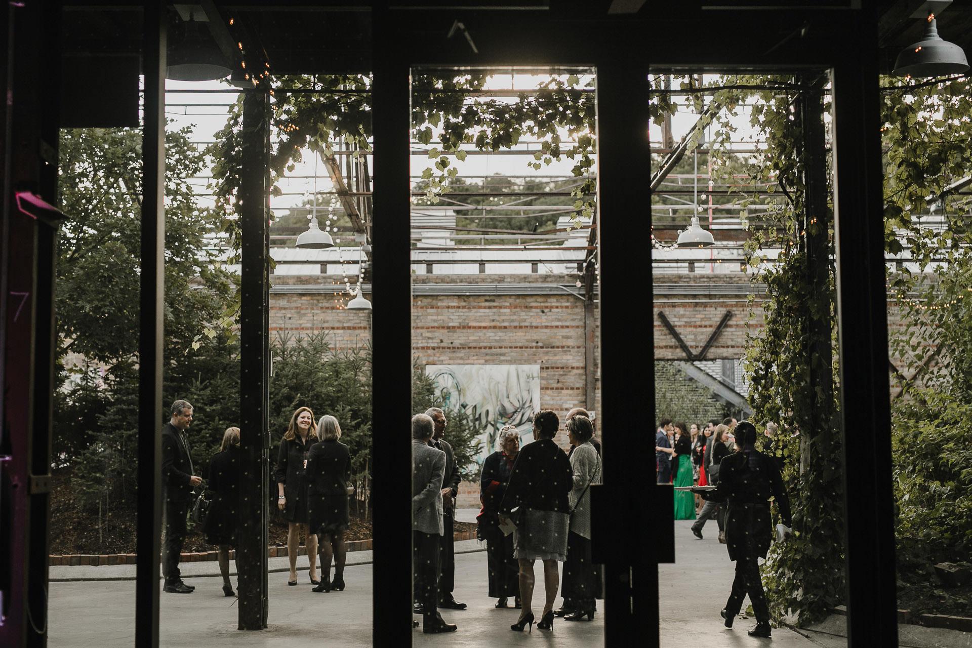 Evergreen Brickworks wedding photographer - cocktails in the attrium