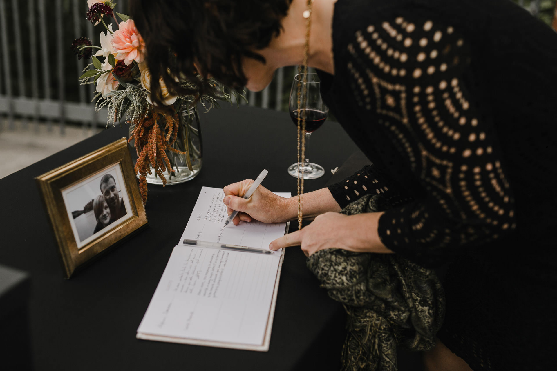Evergreen Brickworks wedding photographer - signing the guest book