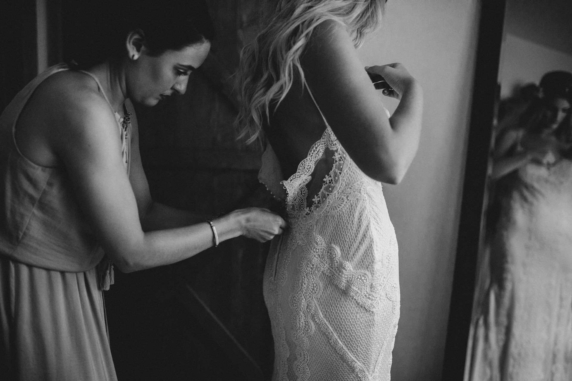 Muskoka Wedding - doing up the dress