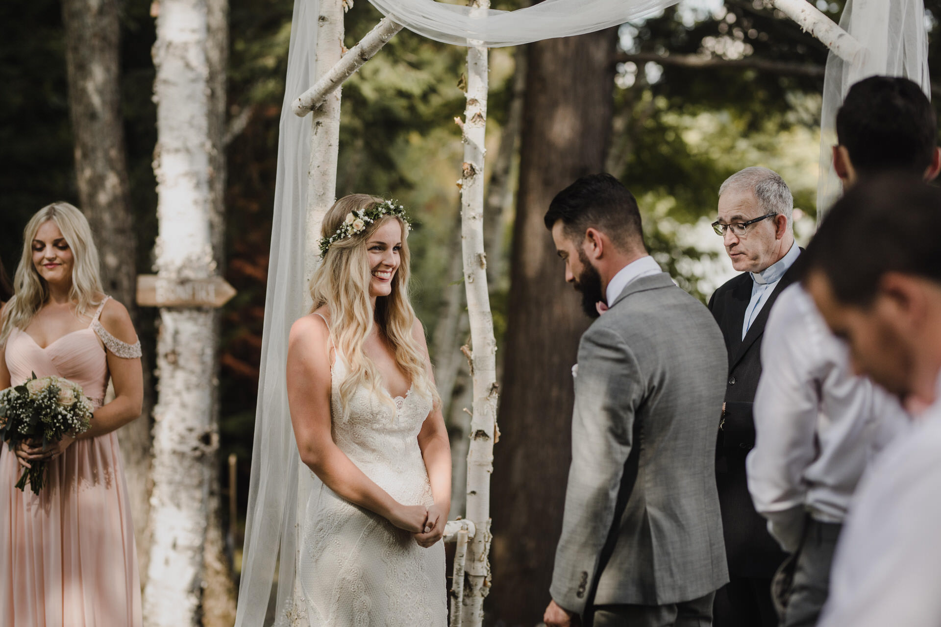 Muskoka Wedding - laughing at the alter