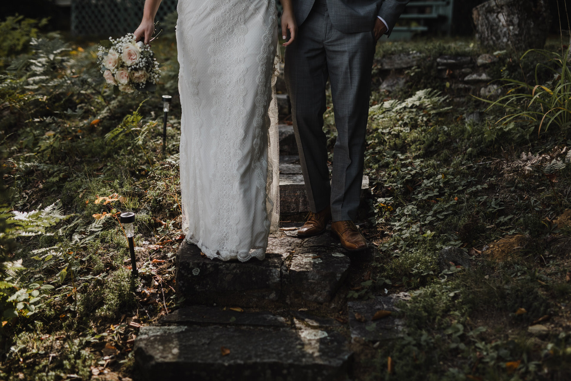 Muskoka Wedding - bride and groom stone steps