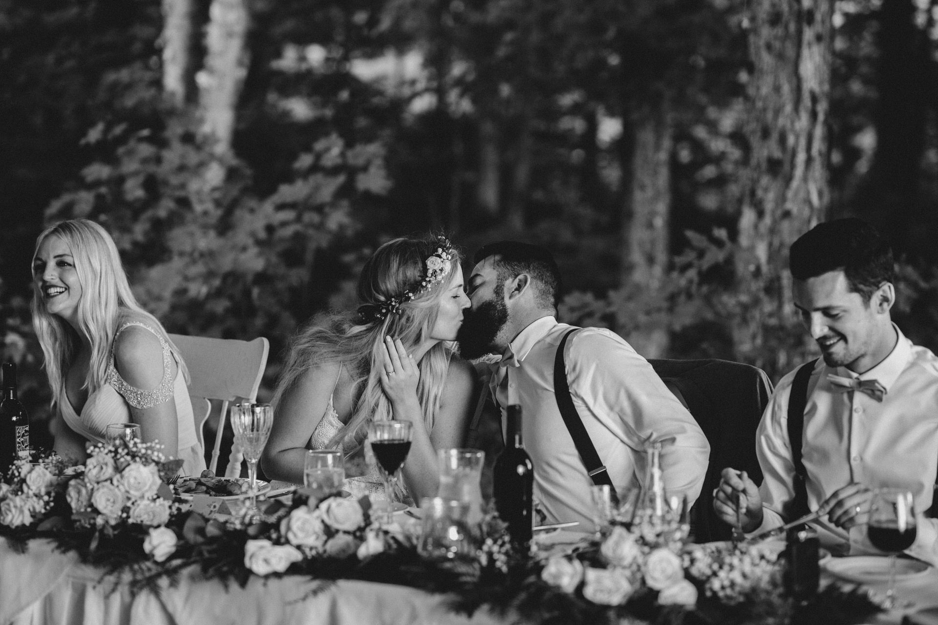Muskoka Wedding - kissing at the table
