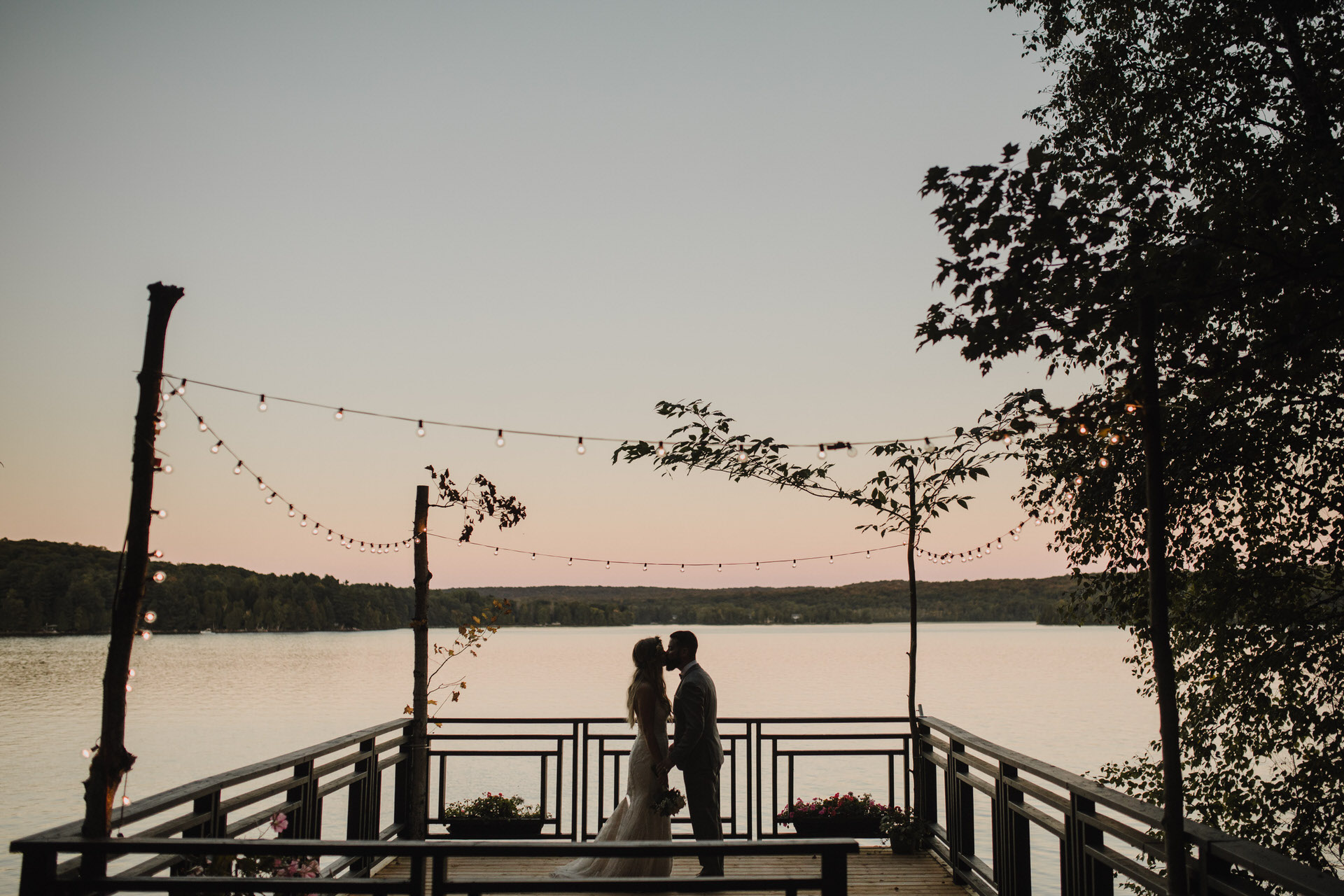 Muskoka Wedding - sunset kisses on the dock