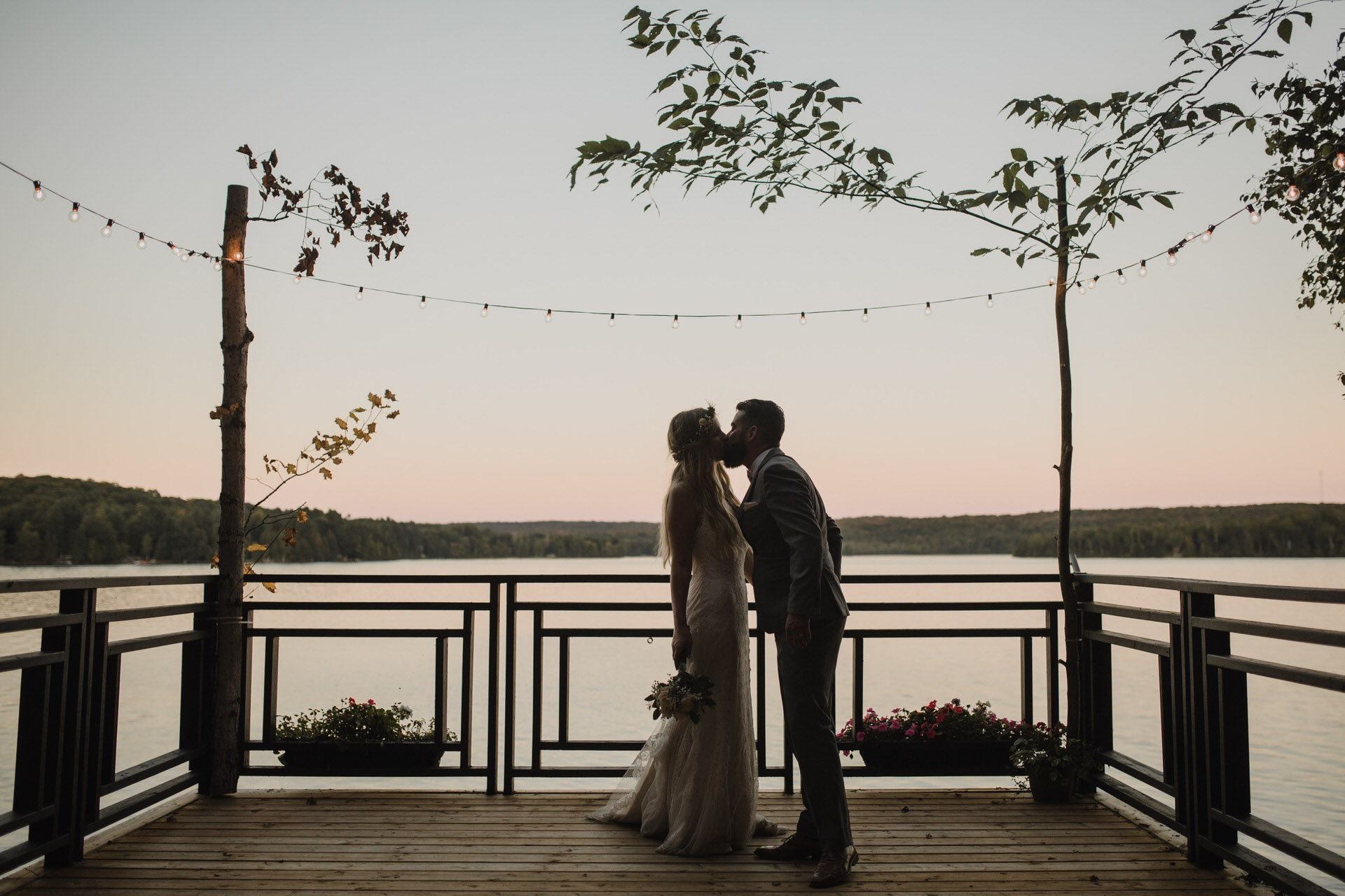 Muskoka Wedding - kissing by the lake