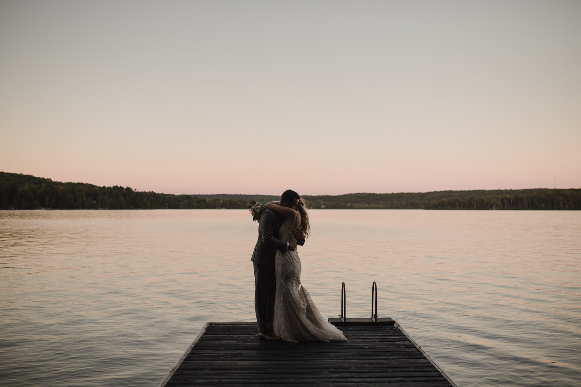 Muskoka Wedding - embrace on the dock